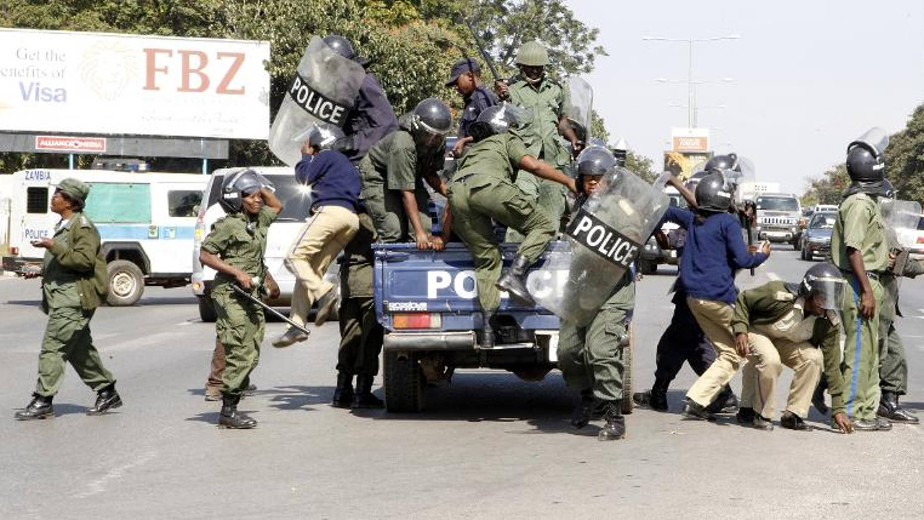 File picture from May shows Zambian police deploying during an operation in Lusaka