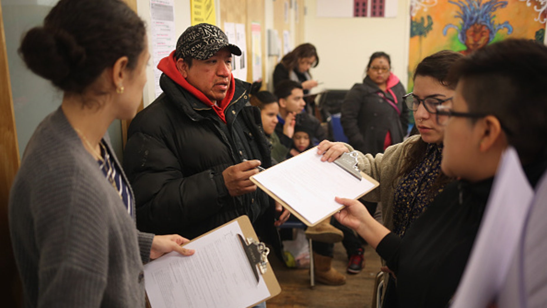 NEW YORK, NY - FEBRUARY 18:  Immigrants fill out forms for Deferred Action for Childhood Arrivals (DACA), at a workshop on February 18, 2015 in New York City. The immigrant advocacy group Make the Road New York holds weekly workshops to help immigrants get legal status under DACA to work in the United States. An expansion of the national program, scheduled for this week, was frozen by a ruling from a Texas federal judge. The Obama Administration plans to appeal the ruling and, if sussessful, DACA would allow legalization of up to two million immigrants who entered the United States before they were age 16.  (Photo by John Moore/Getty Images)