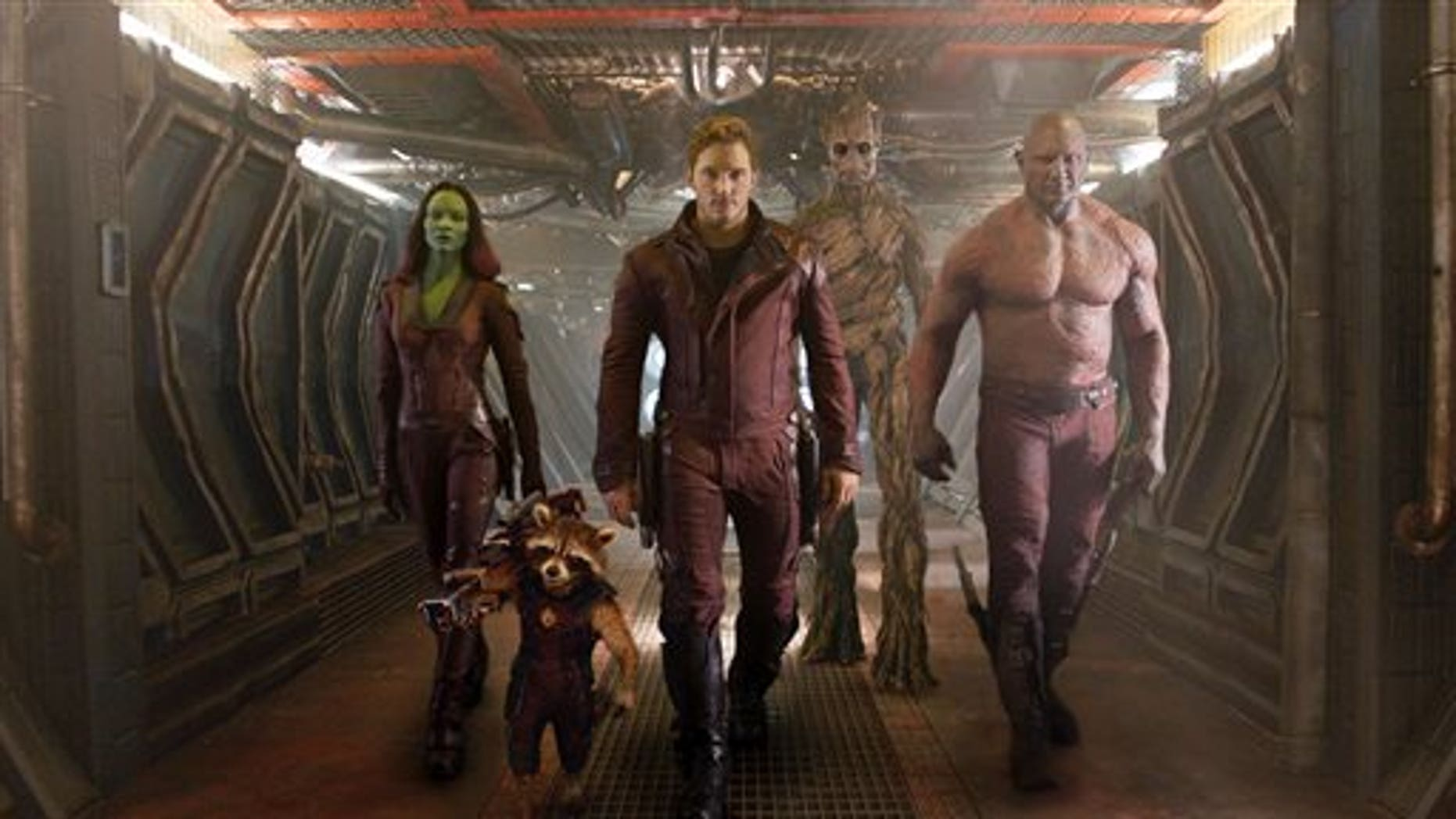 """This image released by Disney - Marvel shows, from left, Zoe Saldana, the character Rocket Racoon, voiced by Bradley Cooper, Chris Pratt, the character Groot, voiced by Vin Diesel, and Dave Bautista in a scene from """"Guardians of the Galaxy."""" The movie releases on Friday, Aug. 1, 2014. (AP Photo/Disney - Marvel)"""