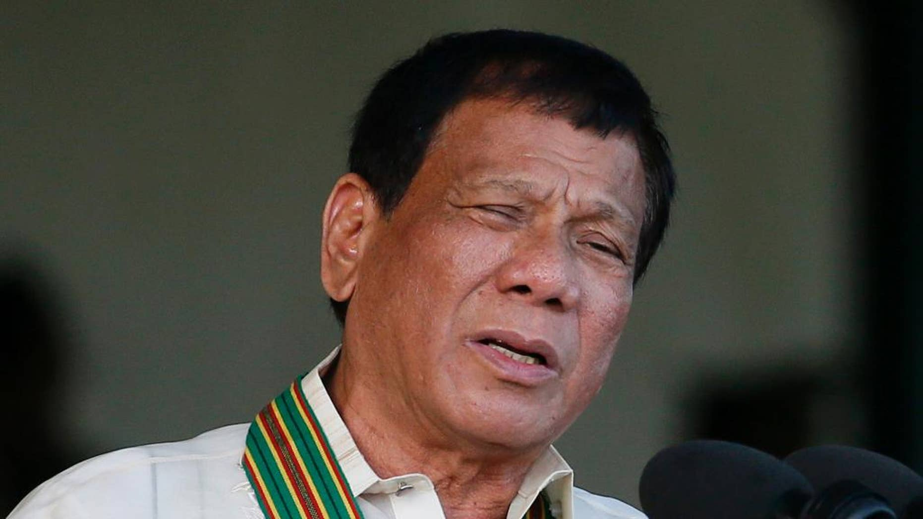 FILE - In this Tuesday, April 4, 2017 file photo, Philippine President Rodrigo Duterte gestures while addressing army troopers during the 120th anniversary celebration of the Philippine Army at Fort Bonifacio in suburban Taguig city, east of Manila, Philippines. Results of an independent poll released Wednesday, April 5 showed a drop in the number of Filipinos who trust President Rodrigo Duterte, although he was still considered trustworthy by three-quarters of the respondents despite an impeachment complaint pending against him. (AP Photo/Bullit Marquez, File)