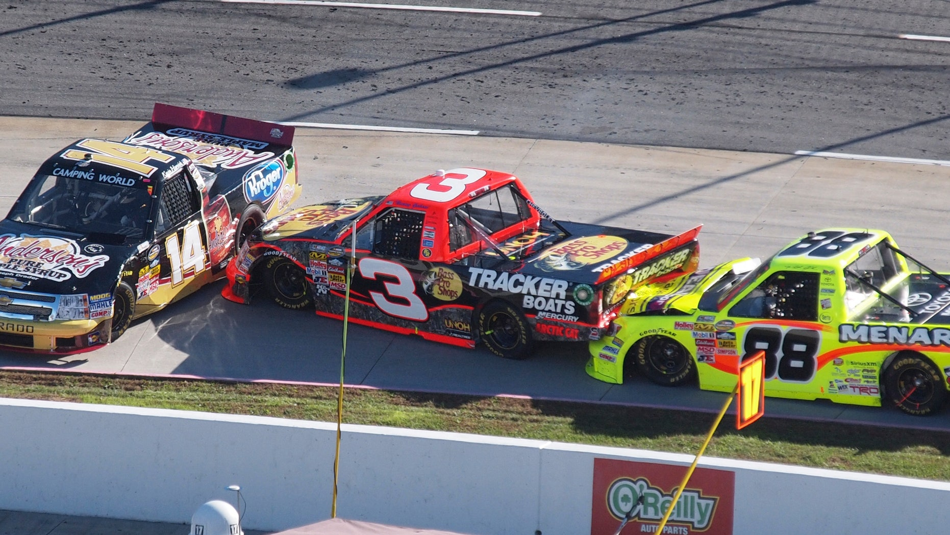 Kevin Harvick (14) spins out in front of Ty Dillon (3) and Matt Crafton (88) during the NASCAR Truck Series truck race at  Martinsville Speedway in Martinsville, Va., Saturday, Oct. 26, 2013. (AP Photo/Steve Sheppard)