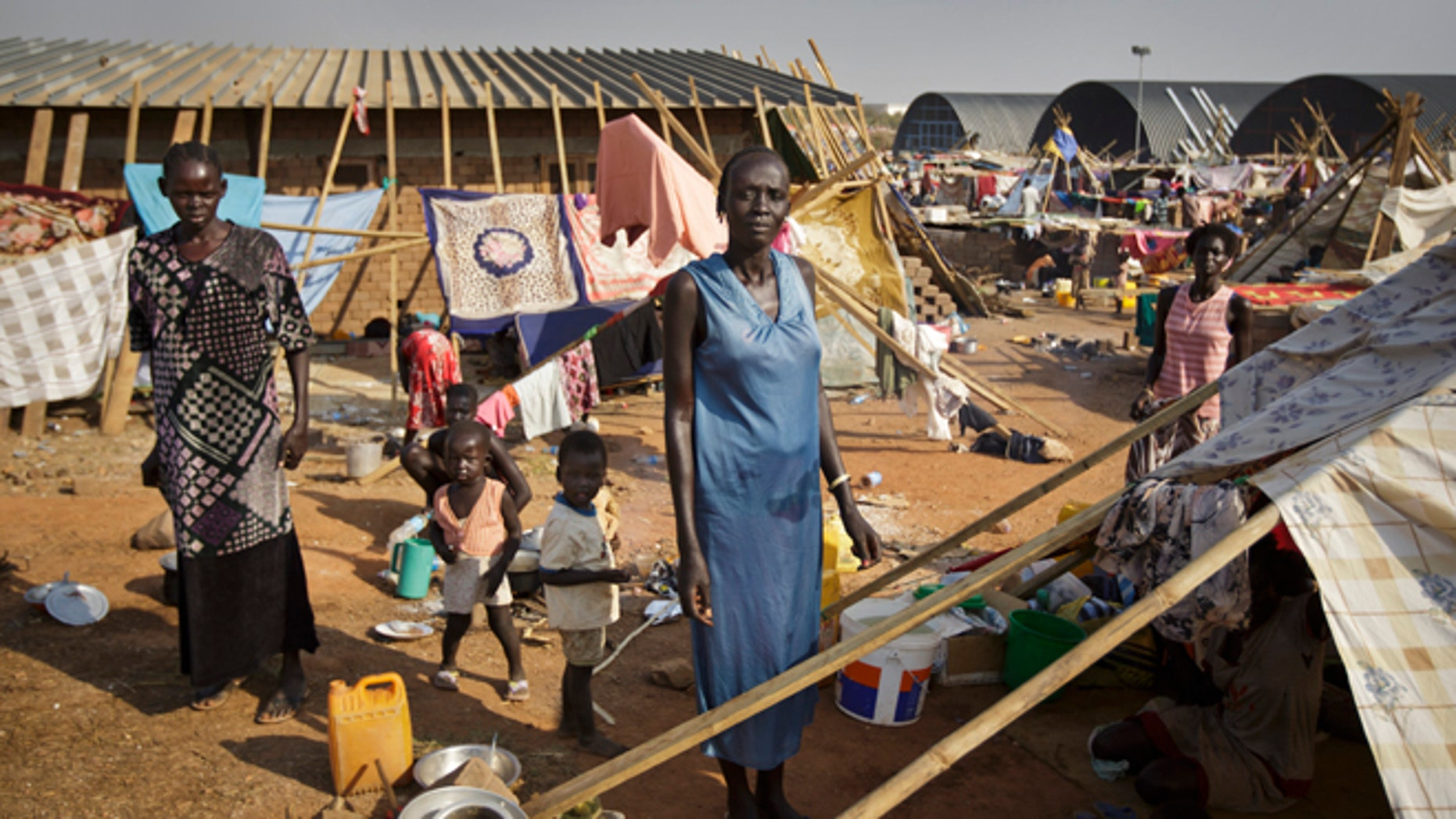 Dec. 31: A displaced family stand by their makeshift shelter at a United Nations compound which has become home to thousands of people displaced by the recent fighting, in the Jebel area on the outskirts of Juba, South Sudan.