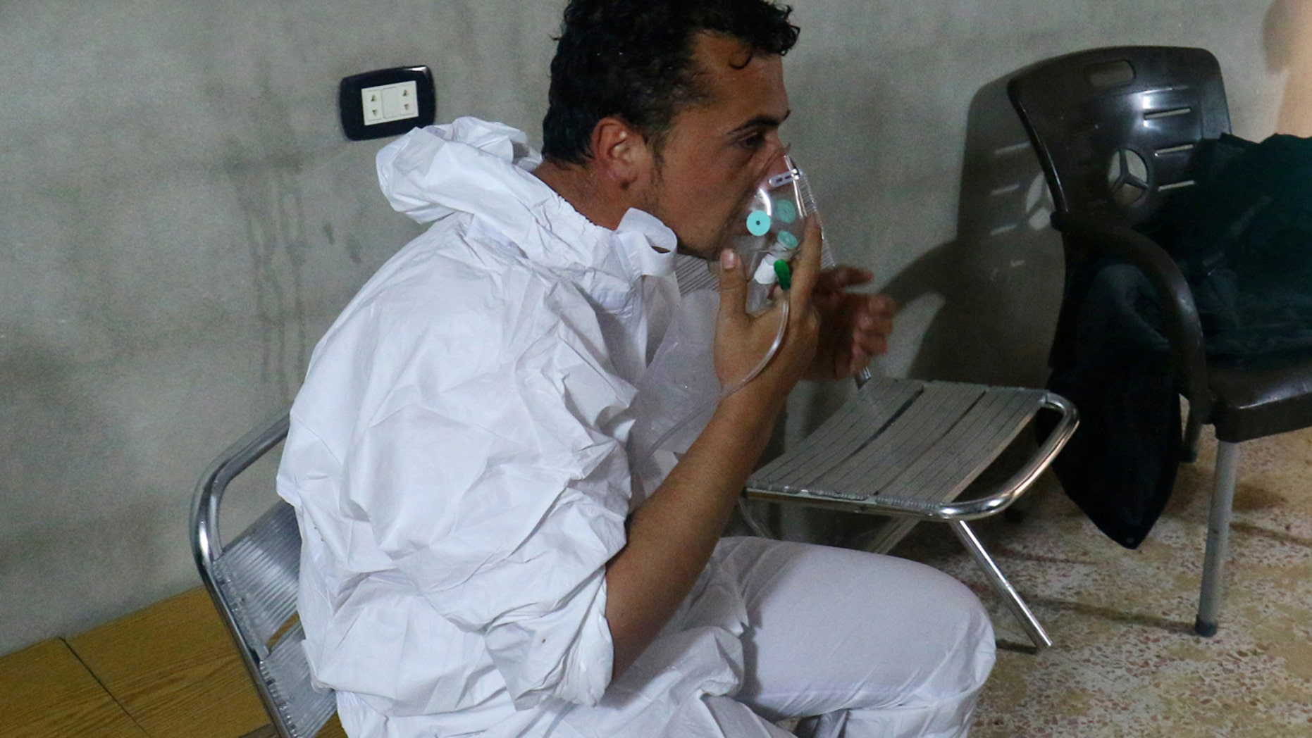 APRIL 4:  man breathes through an oxygen mask, after what rescue workers described as a suspected gas attack in the town of Khan Sheikhoun.