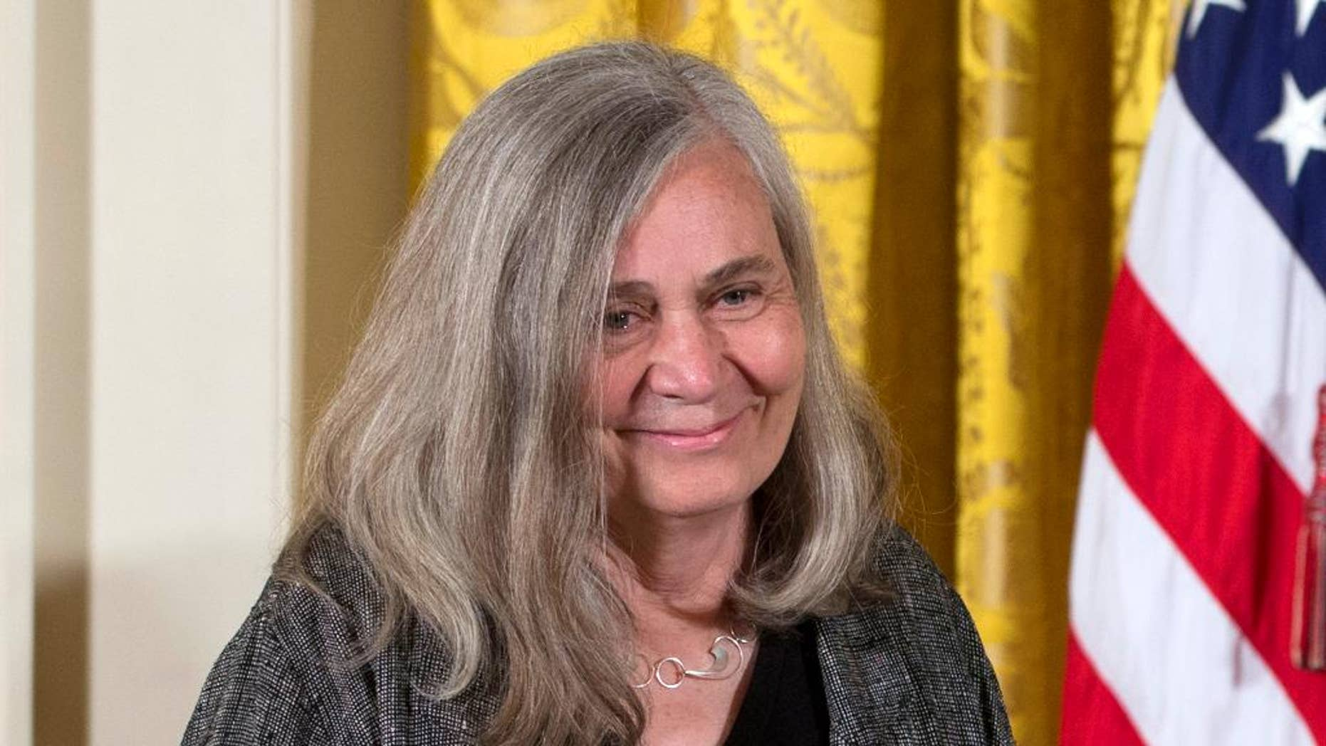 "FILE - In this July 10, 2013, file photo, Marilynne Robinson appears at a ceremony awarding her the 2012 National Humanities Medal for  grace and intelligence in writing in the East Room of White House in Washington. Robinson, the acclaimed author of such novels as ""Gilead"" and ""Housekeeping,"" is this year's winner of the Library of Congress Prize for American Fiction, a lifetime achievement honor. (AP Photo/Carolyn Kaster, File)"