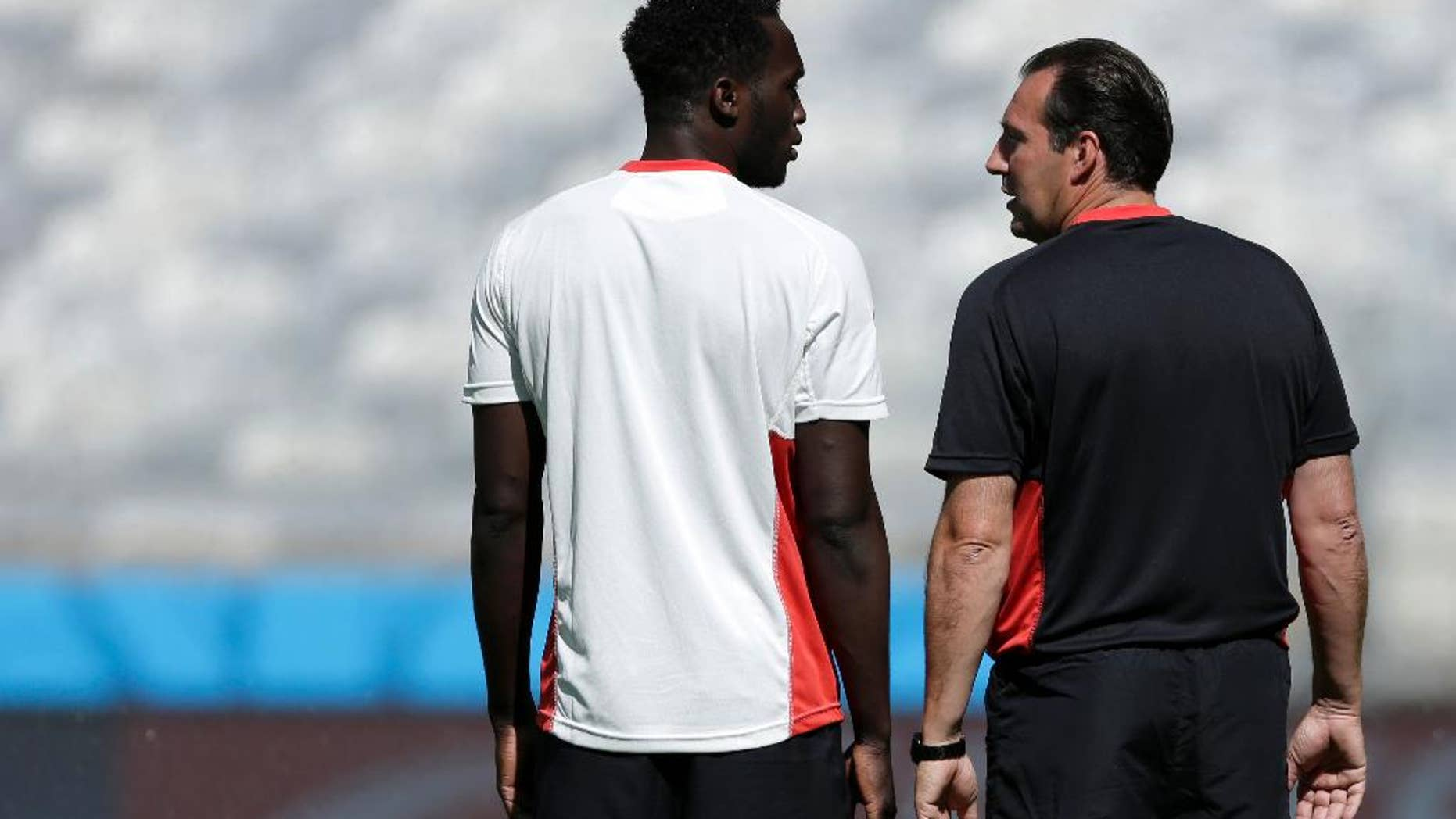 Belgium's Romelu Lukaku and head coach Marc Wilmots talk at the start of a training session at the Mineirao Stadium in Belo Horizonte, Brazil, Monday, June 16, 2014. Belgium will play in group H of the Brazil 2014 soccer World Cup. (AP Photo/Bruno Magalhaes)