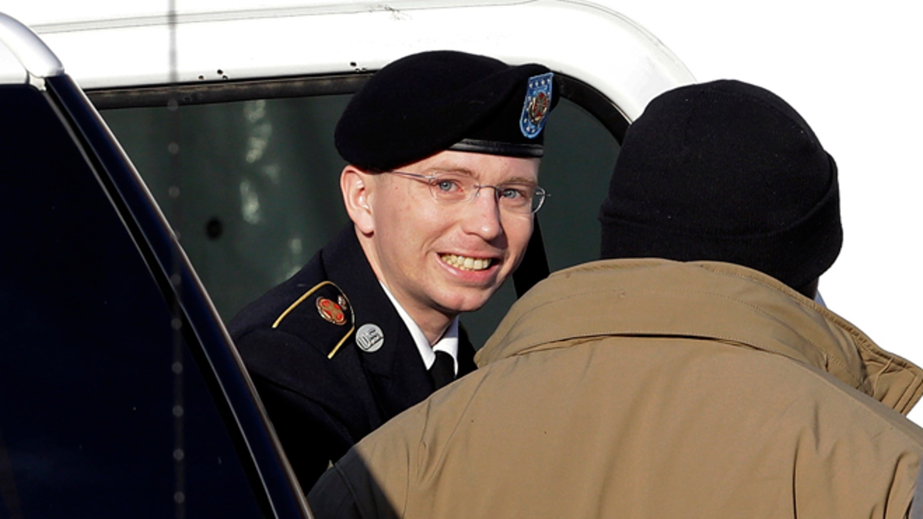 Nov. 28: Army Pfc. Bradley Manning, center, steps out of a security vehicle as he is escorted into a courthouse in Fort Meade, Md.