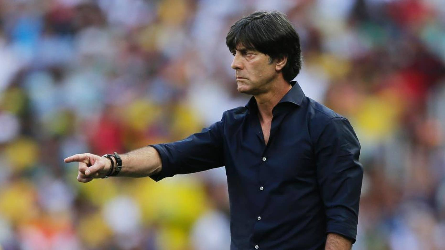 Germany's head coach Joachim Loew gestures during the group G World Cup soccer match between Germany and Ghana at the Arena Castelao in Fortaleza, Brazil, Saturday, June 21, 2014. (AP Photo/Matthias Schrader)