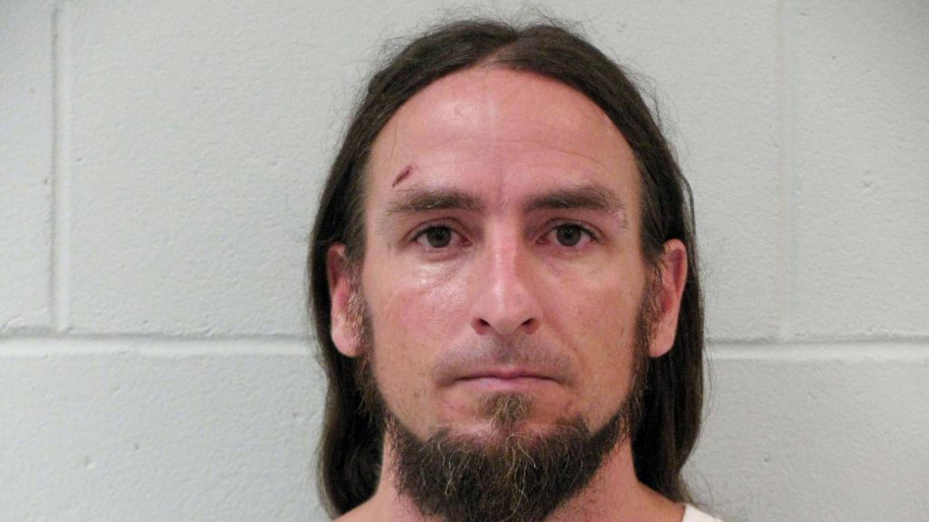 """Huckleberry Finn is shown in a photo provided by the Keene, N.H. Police Department. Keene police say a man named Huckleberry Finn followed a woman into her home on July 25 and sexually assaulted her. Keene police stressed that the 36-year-old man's real name is the same as the fictional protagonist in Mark Twain's """"Adventures of Huckleberry Finn.""""  He was arrested Wednesday, July 29, and was being held on $25,000 bail. (Keene, N.H. Police Department via AP)"""