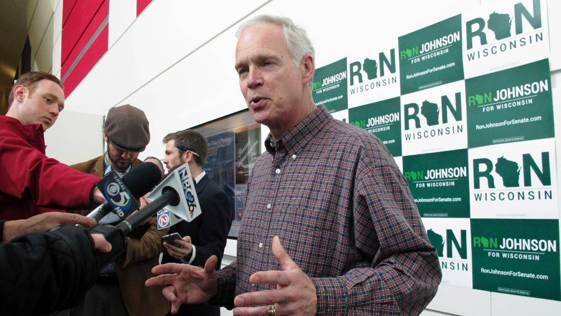 U.S. Sen. Ron Johnson, R-Wis., speaks with reporters Friday, May 13, 2016, in Green Bay, Wis., ahead of the Wisconsin Republican Party convention. Johnson says he is sympathetic with Donald Trump as the presumptive Republican presidential nominee tries to get smart on policy and win over fellow Republicans. (AP Photo/Scott Bauer)