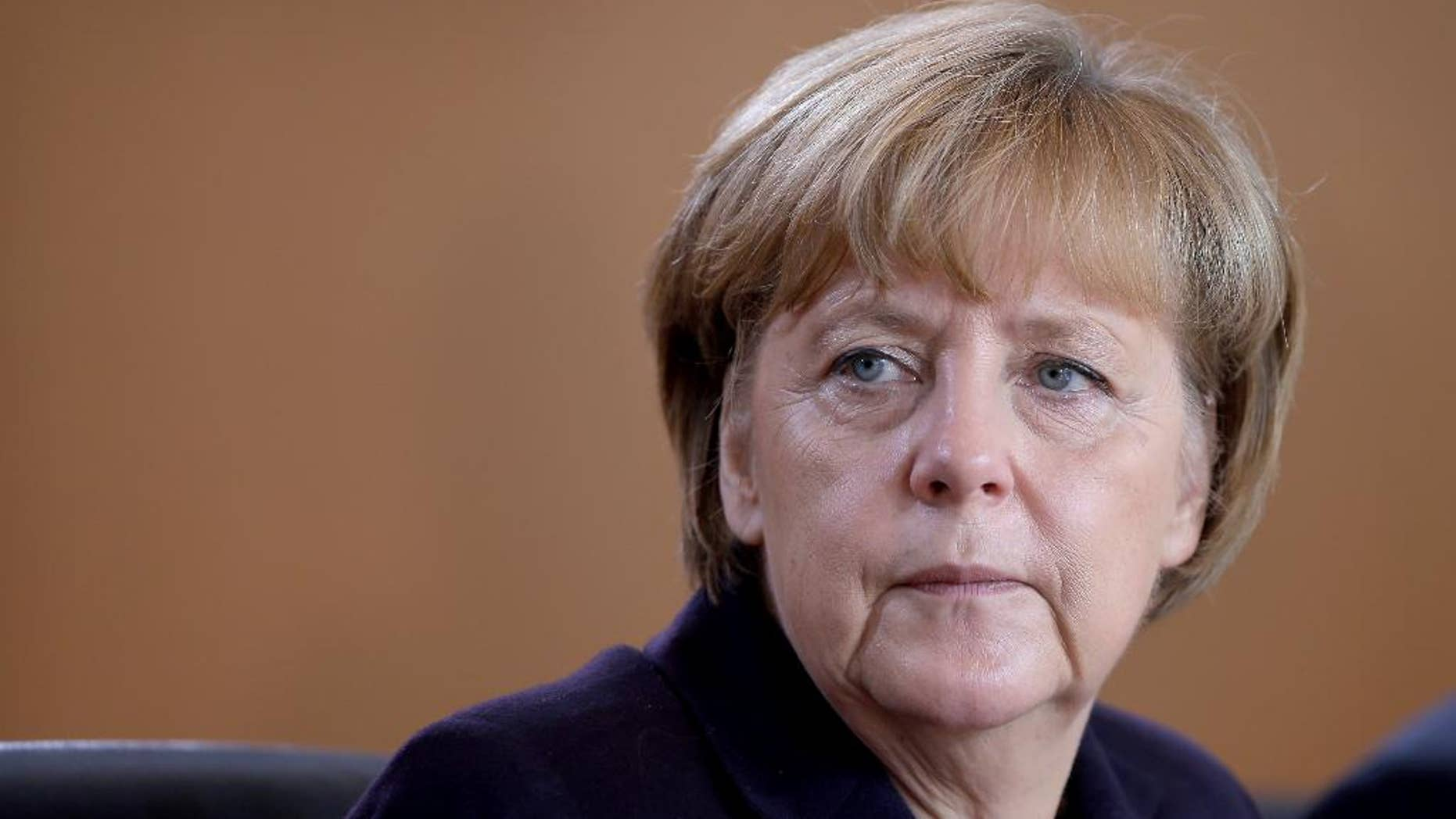 German Chancellor Angela Merkel attends the beginning of the weekly cabinet meeting at the chancellery in Berlin, Germany, Wednesday, Nov. 5, 2014. (AP Photo/Michael Sohn)