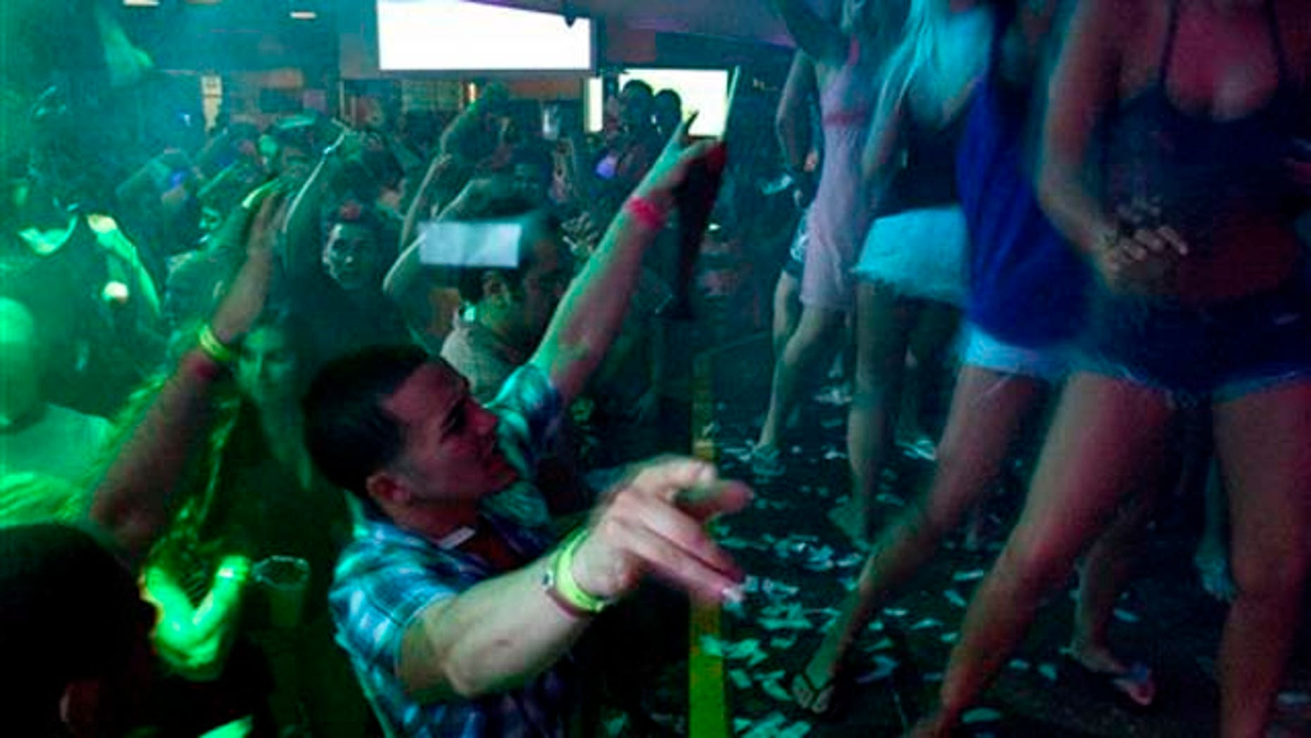 FILE-   This Thursday, March 18, 2010 file photo shows spring break revelers as they dance at the Senor Frog's nightclub in Cancun, Mexico. Despite headlines about Mexico's violent drug war, tourism remains relatively strong this year and Cancun is still expecting spring-breakers.   (AP Photo/Israel Leal, FILE)
