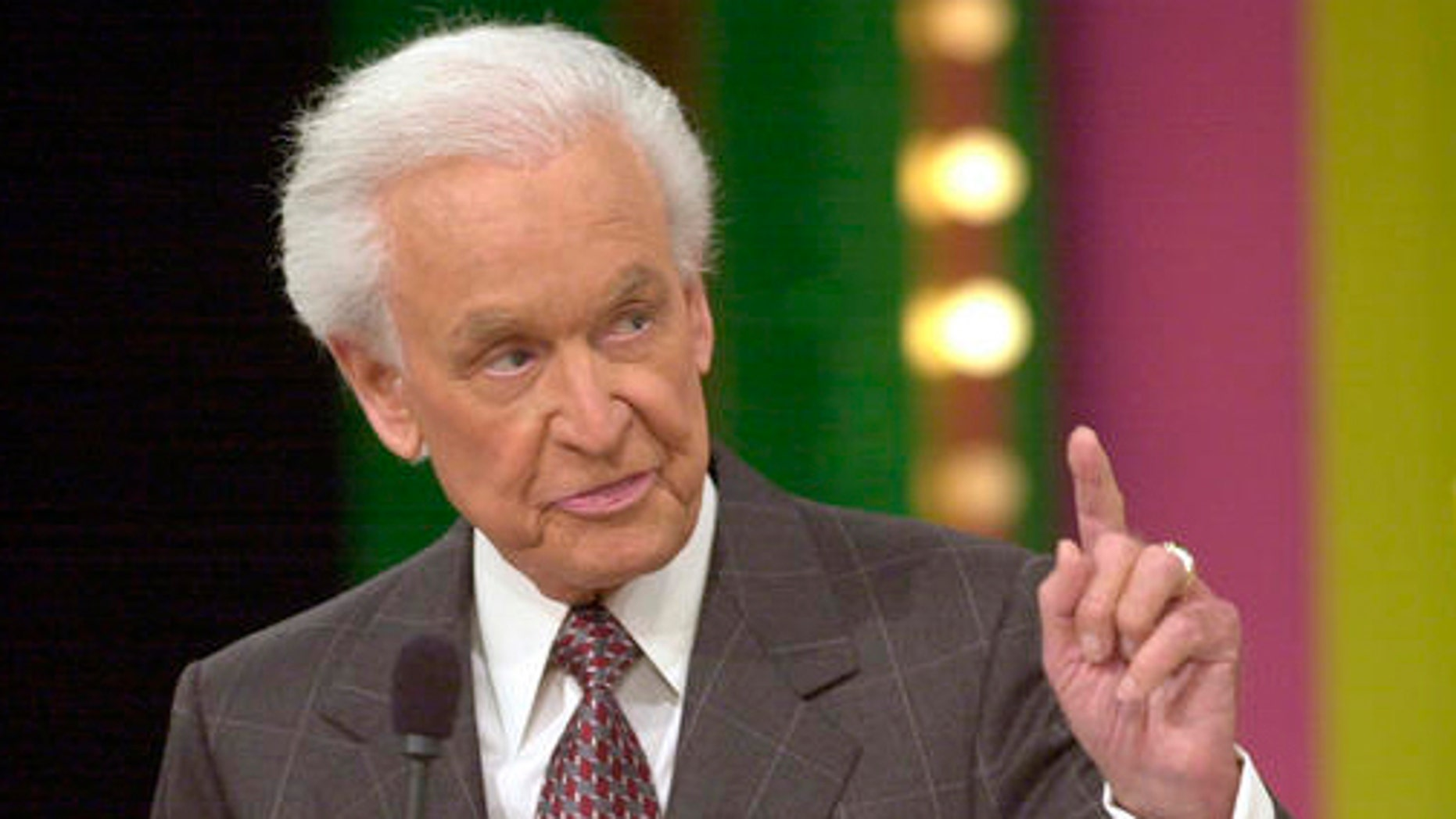 """**FILE**Bob Barker, 79, host of game show """"The Price is Right,"""" gestures during taping of a show on, Jan. 15, 2003, in Los Angeles. Barker has agreed to continue as host of """"The Price Is Right"""" for a record 34th season, CBS announced Monday, Jan. 3, 2005.(AP Photo/Nick Ut)"""
