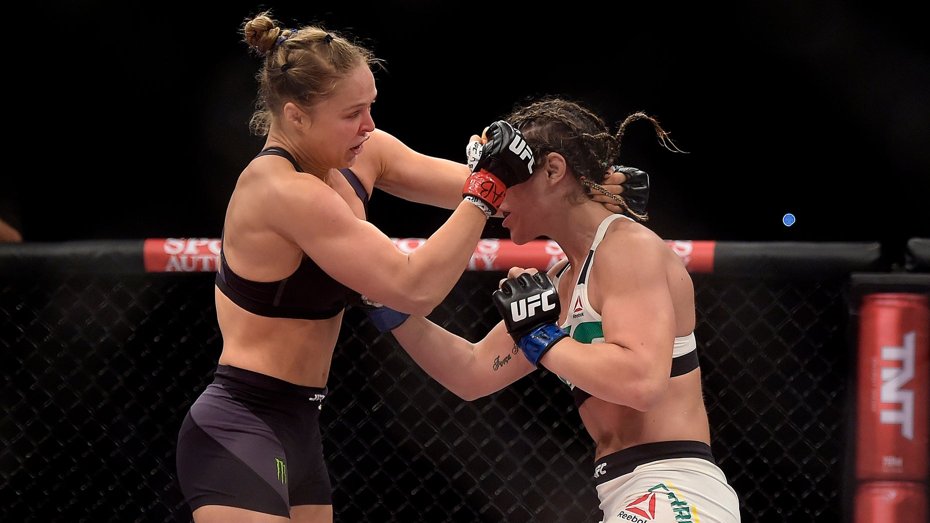 In this photo released by Inovafoto, Ronda Rousey, left, of the United States, battles Brazil's Bethe Correia during their mixed martial arts bantamweight title fight at UFC 190, early Sunday, Aug. 2, 2015, in Rio de Janeiro, Brazil. Rousey knocked out Correia 34 seconds into the first round to win. (Alexandre Loureiro/Inovafoto via AP)