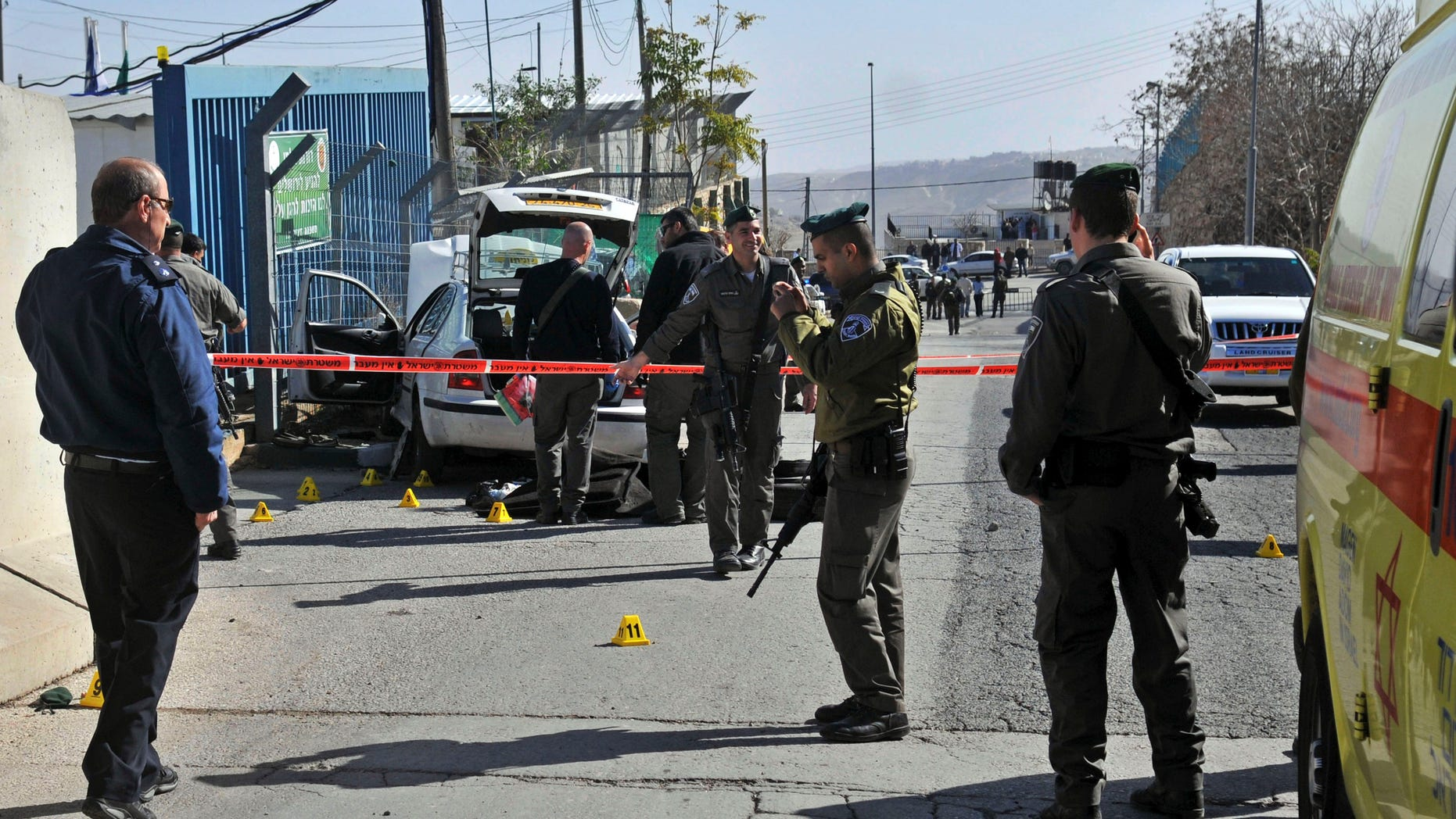 Israeli police cordon off the area next to the site of an attempted attack outside a police station in Jabel Mukaber, in east Jerusalem, Sunday, Dec. 23, 2012. According to Israeli police spokesman and Palestinian sources an Arab taxi driver tried to drive into the police station and was prevented by border policemen who fired shots to stop the vehicle. Both the driver and a police officer were lightly injured in the incident. (AP Photo/Mahmoud Ilean)