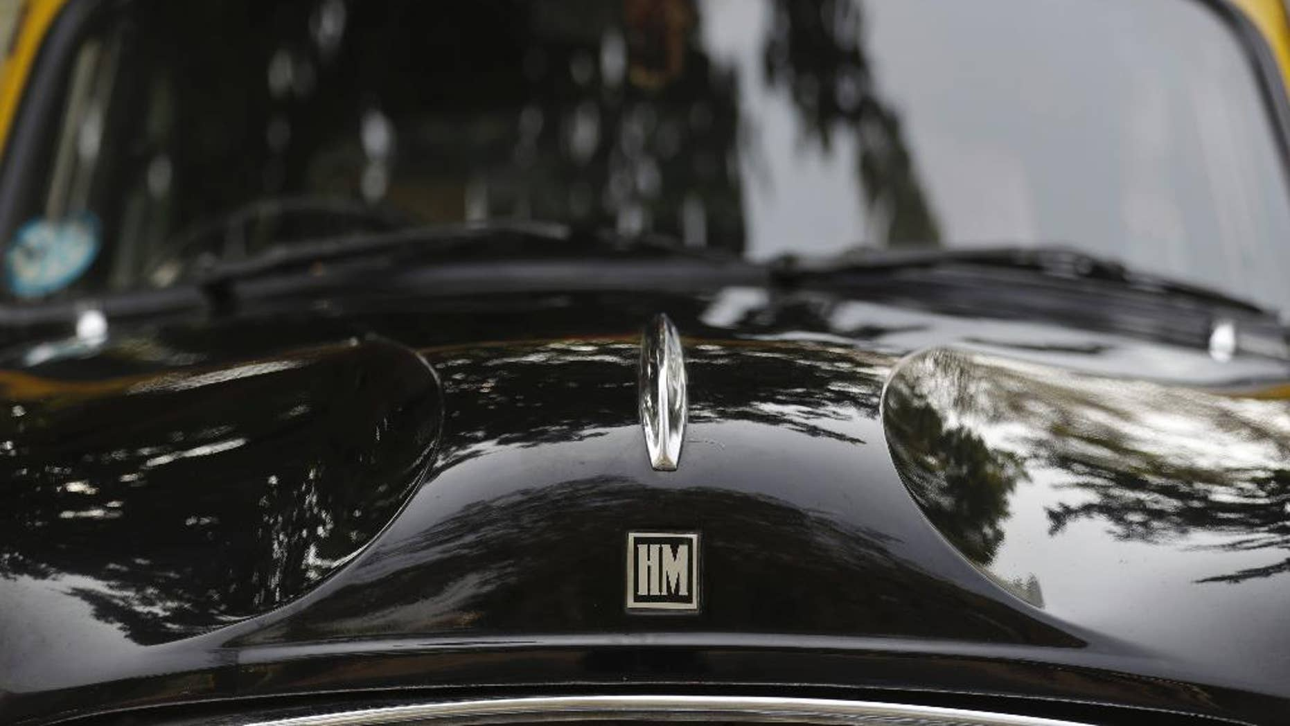 Close up Hindustan Ambassadors taxi in New Delhi, India, Monday, Feb. 13, 2017. Over the weekend, the C.K. Birla Group that owns Hindustan Motors said it had signed an agreement with Peugeot SA to sell the Ambassador for 800 million rupees ($12 million). (AP Photo/Tsering Topgyal)