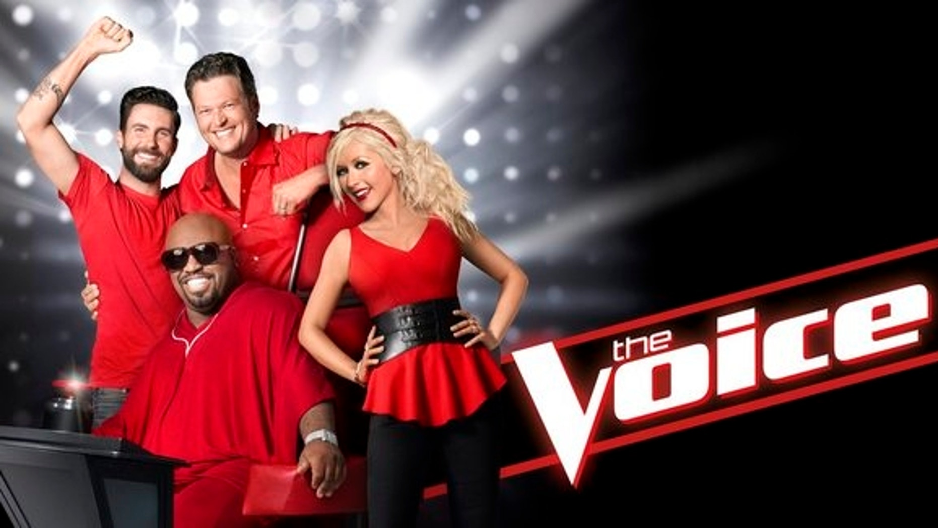 """Adam Levine, CeeLo Green, Blake Shelton and Christina Aguilera pose for a promotional photo for """"The Voice."""""""