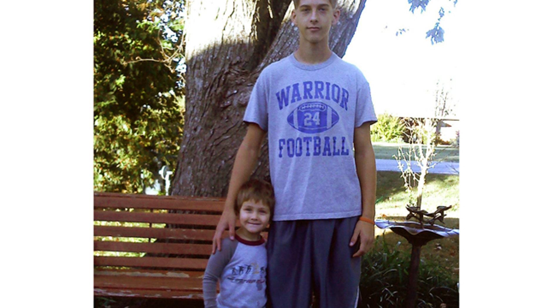 This 2011 photo provided by Joey Dawson shows Dawson and his nephew Caleb Linn.