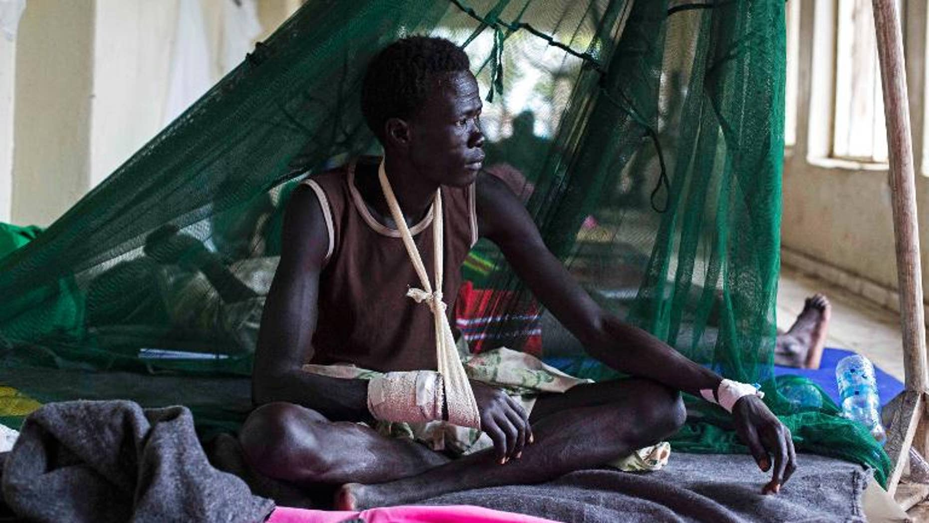 A man injured during tribal clashes sits in a hospital in Bor, South Sudan on July 15.