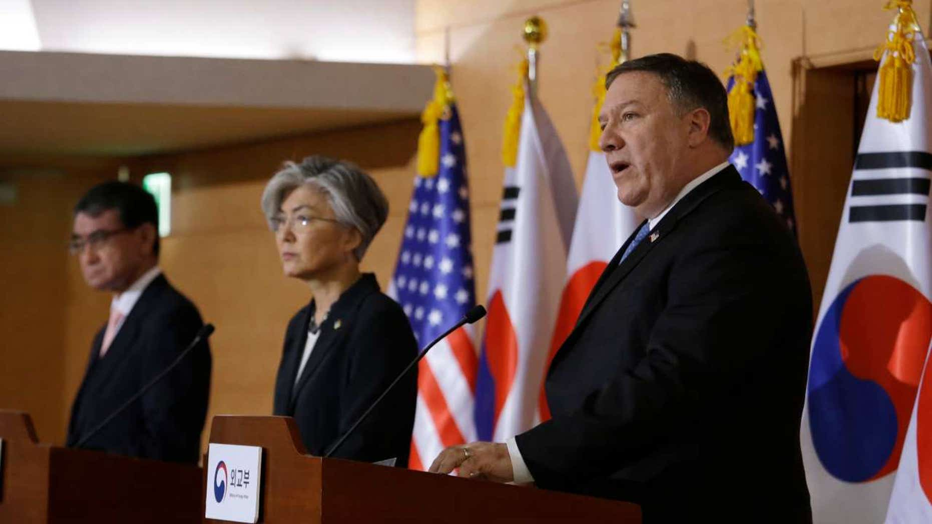 U.S. Secretary of State Mike Pompeo, right, speaks as South Korean Foreign Minister Kang Kyung-wha, center, and Japanese Foreign Minister Taro Kono listen during a joint news conference in Seoul, June 14, 2018.