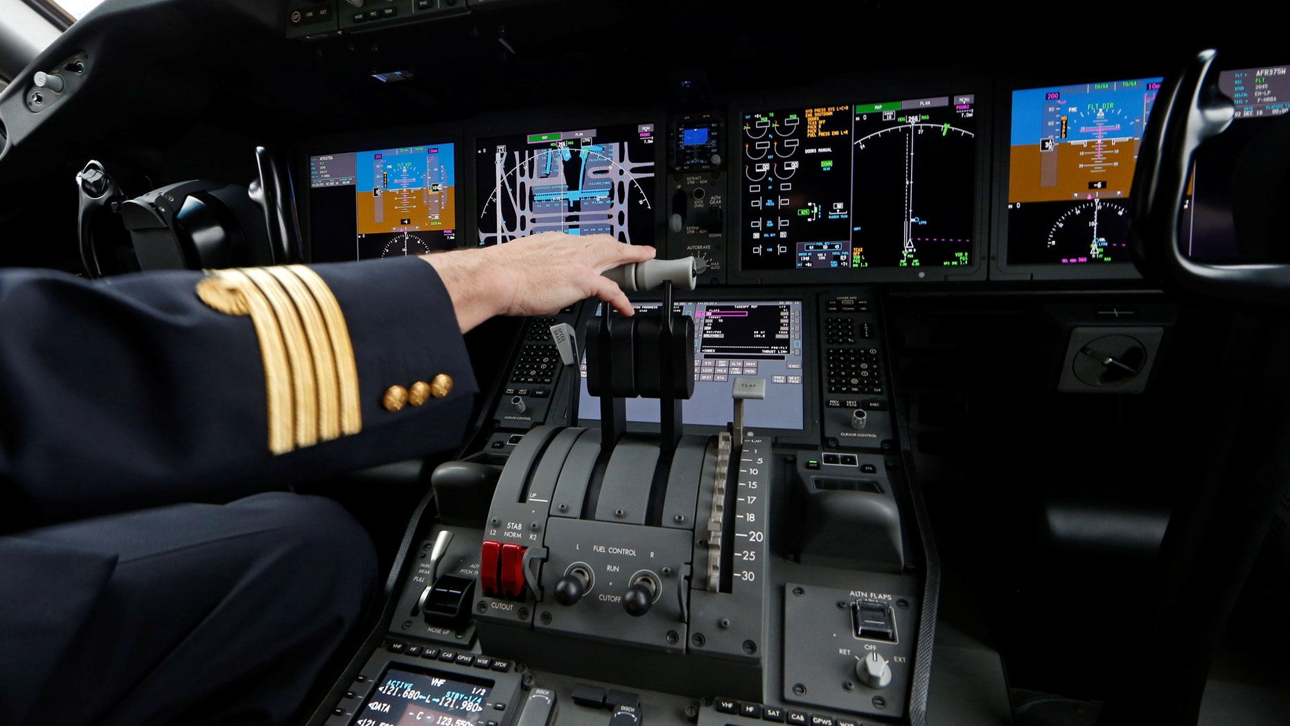 File photo: An Air France pilot stands in the cockpit of the airline's new Boeing Inc. 787-9 Dreamliner passenger aircraft as it stands on the tarmac at Charles de Gaulle Airport in Roissy, France, December 2, 2016. (REUTERS/Benoit Tessier)