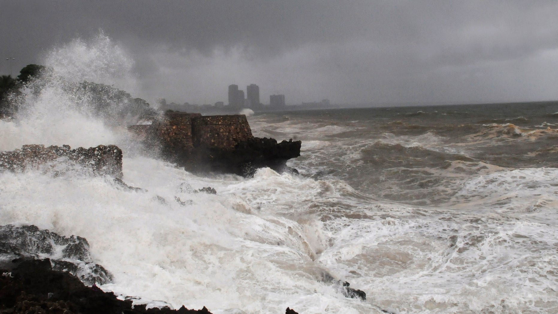 High waves crash into the Santo Domingo waterfront as Tropical Storm Emily approaches the shores of the Dominican Republic. Forecasters say Emily will drop a huge amount of rain on the Dominican Republic and Haiti.