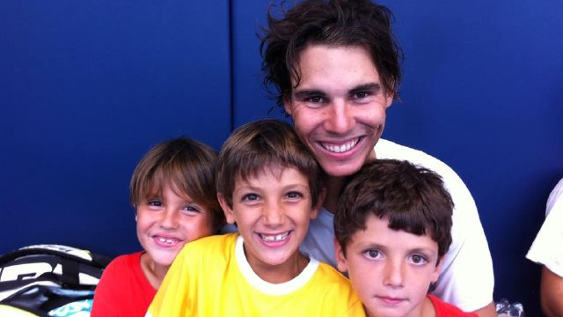 Aug 2: Rafael Nadal posted this photo of him and his three little cousins at his training center.