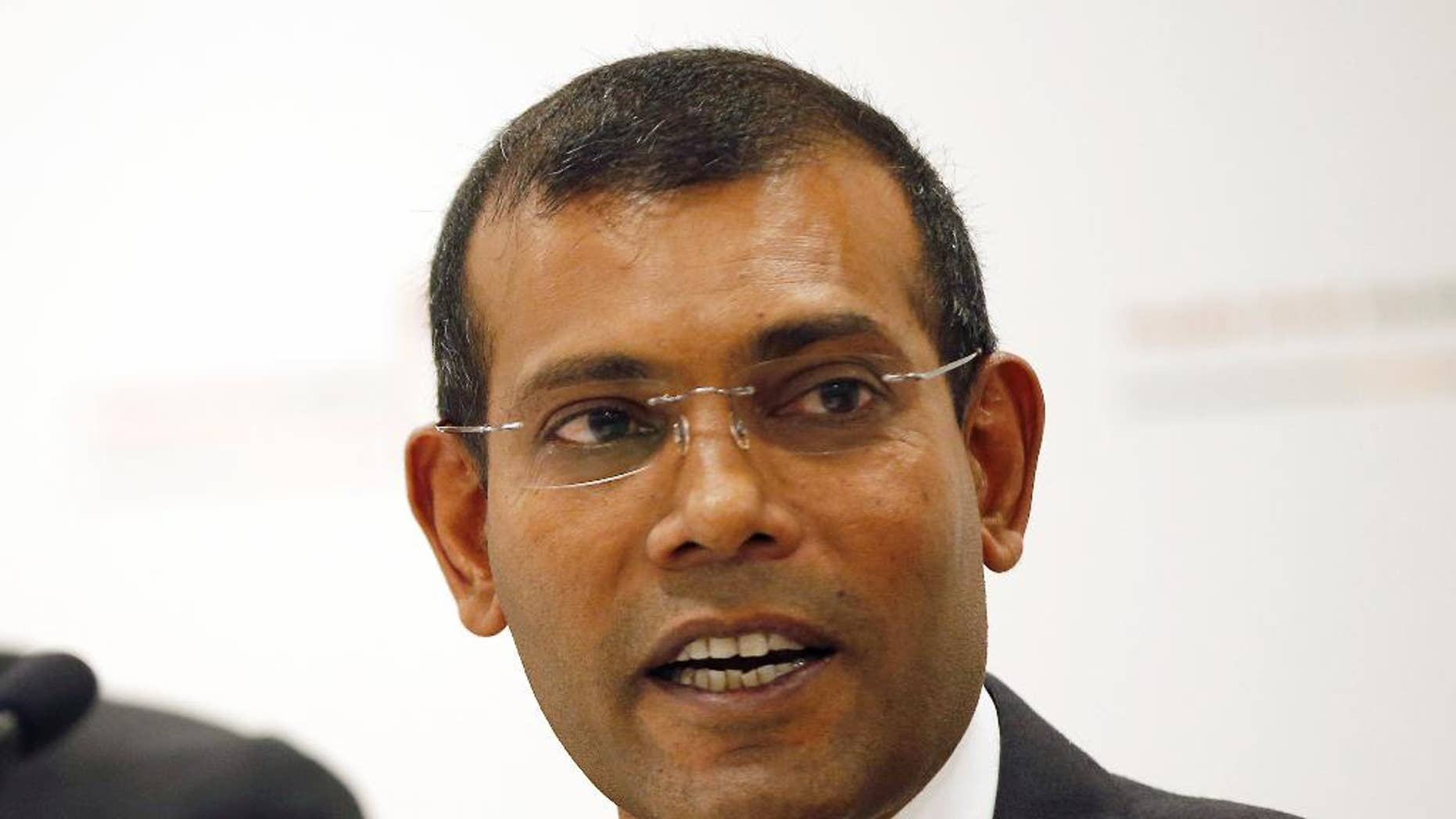 FILE - In this Monday, Jan. 25, 2016, file photo, former Maldives president Mohamed Nasheed speaks during a press conference in London. Nasheed, the first democratically elected president of the Maldives, said Tuesday from exile in Britain that he has an agreement with the country's former strongman Maumoon Abdul Gayoom to counter the current president President Yameen Abdul Gayoom, who is increasing his stranglehold on power. (AP Photo/Alastair Grant, File)