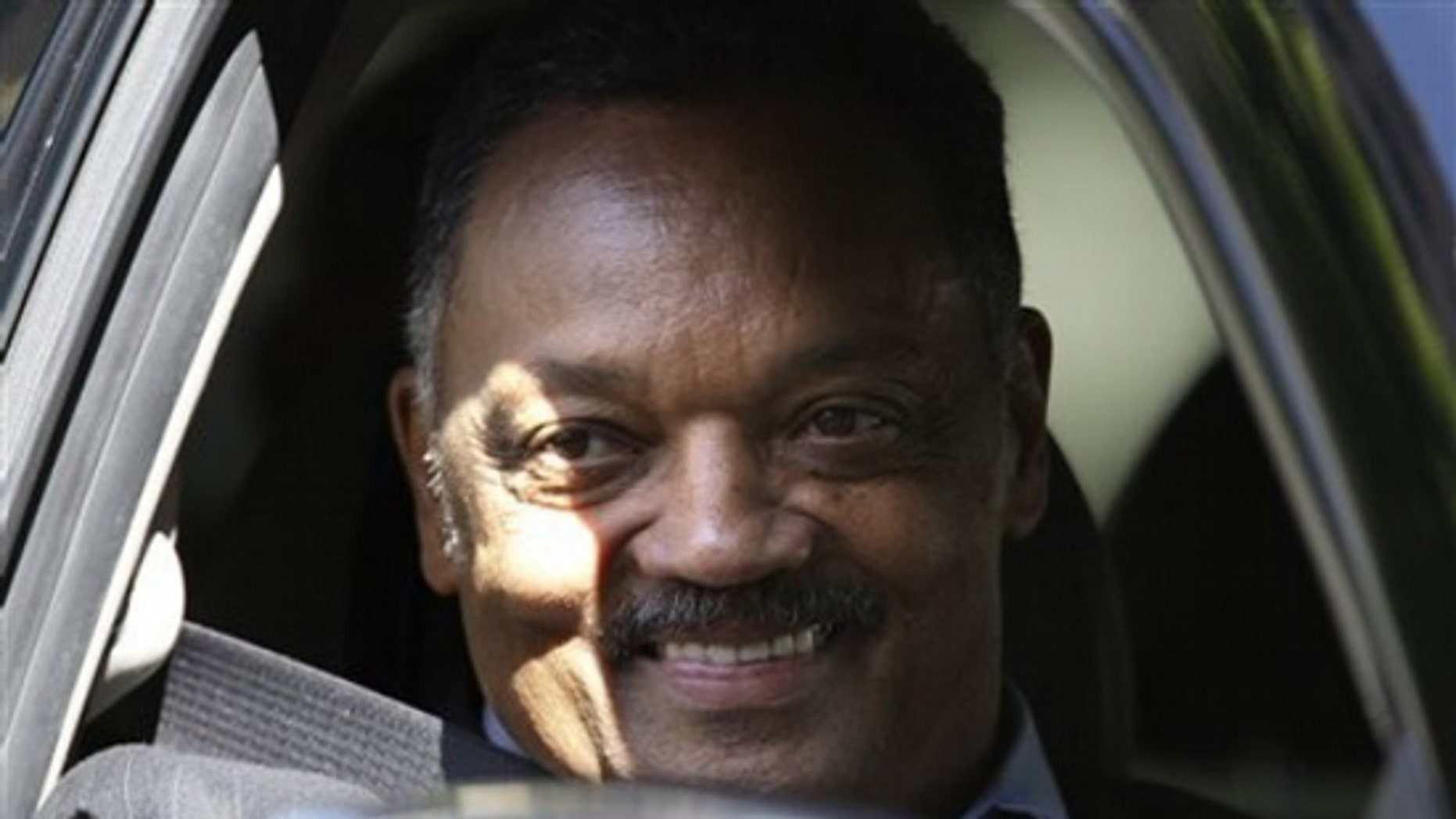 Rev. Jesse Jackson smiles at fans as he departs the Beverly Wilshire Hotel, Tuesday, July 7, 2009 in Beverly Hills after attending the Michael Jackson memorial in Los Angeles at the Staples Center. (AP Photo/Carolyn Kaster)