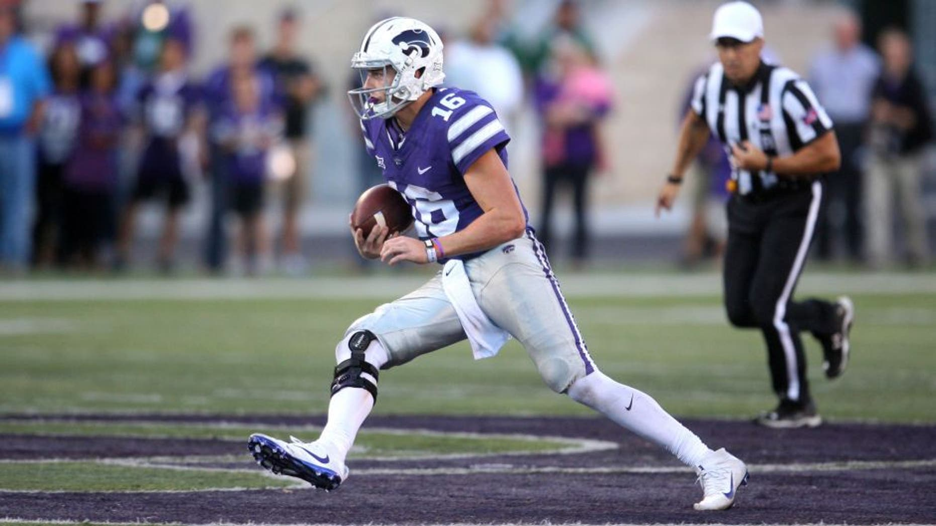 Nov 5, 2016; Manhattan, KS, USA; Kansas State Wildcats quarterback Jesse Ertz (16) finds room to run against the Oklahoma State Cowboys at Bill Snyder Family Football Stadium. The Cowboys won 43-37. Mandatory Credit: Scott Sewell-USA TODAY Sports