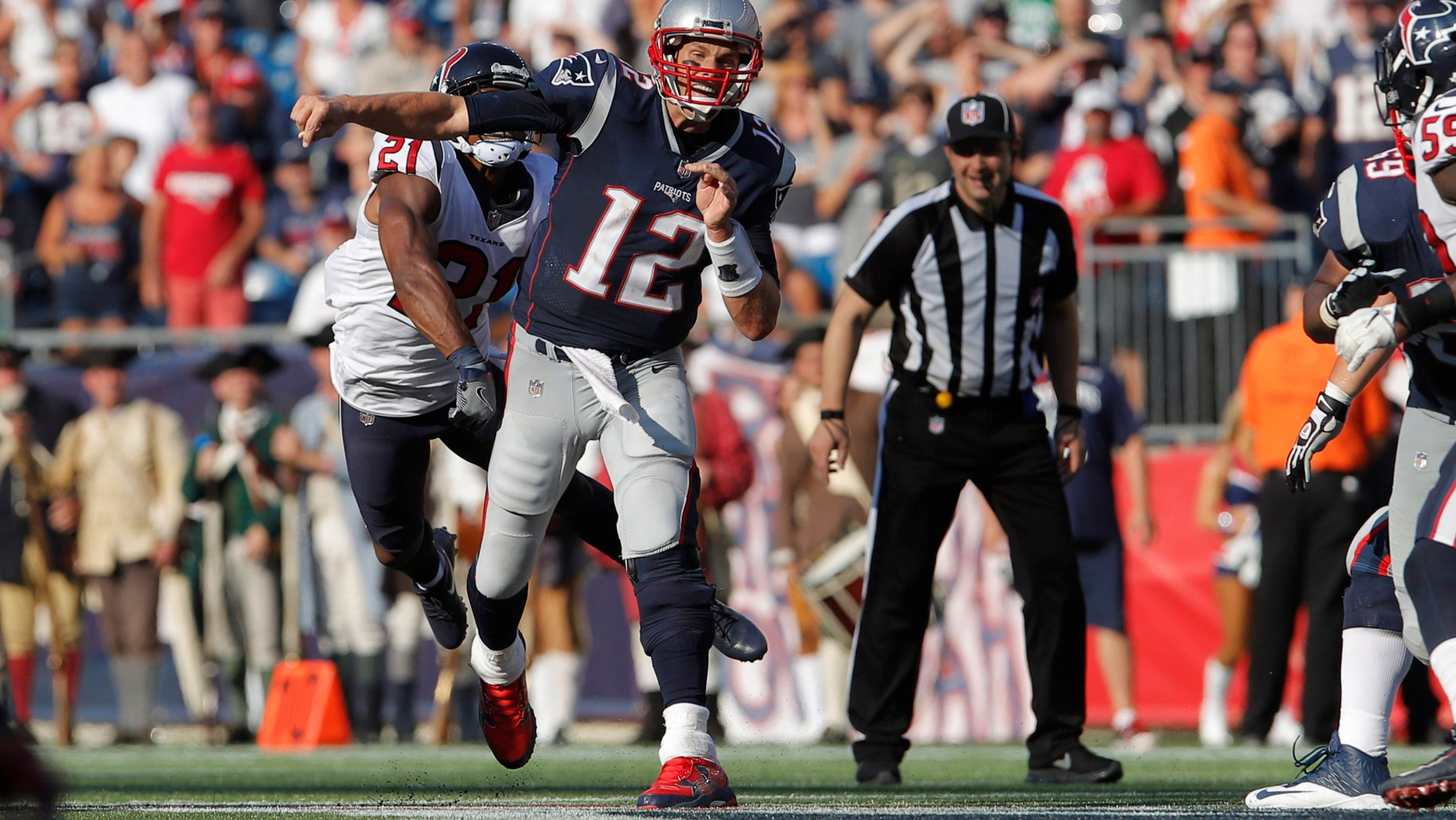 Sep 24, 2017; Foxborough, MA, USA; Houston Texans defensive back Marcus Gilchrist (21) hits the arm of New England Patriots quarterback Tom Brady (12) in the second half at Gillette Stadium. Mandatory Credit: David Butler II-USA TODAY Sports - 10304422