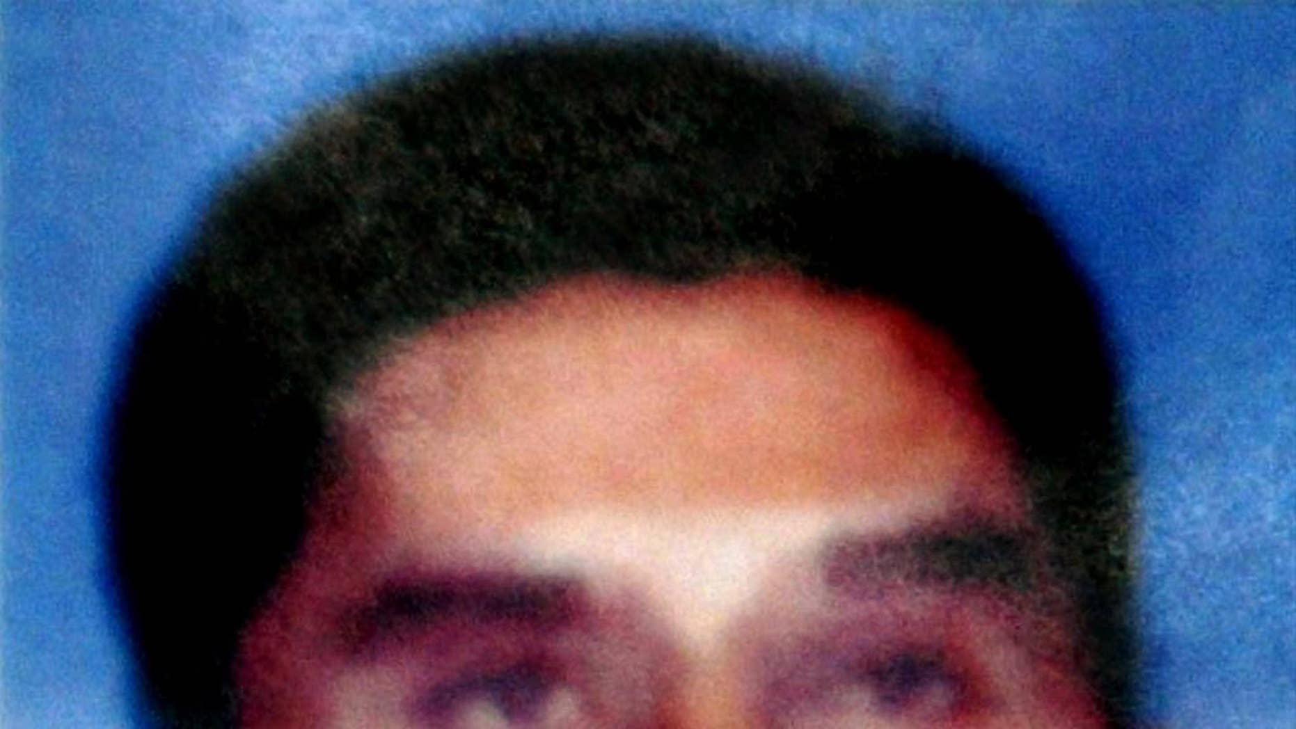 In this photo released by Indonesian National Police on Aug. 21, 2003, Southeast Asian terror mastermind Hambali is shown. Encep Nurjaman, who's known as Hambali, an Indonesian held for nearly 10 years at the U.S. military prison at Guantanamo Bay, Cuba, has appeared for the first time at a hearing called to determine whether he should remain in detention.  (Indonesian National Police via AP)
