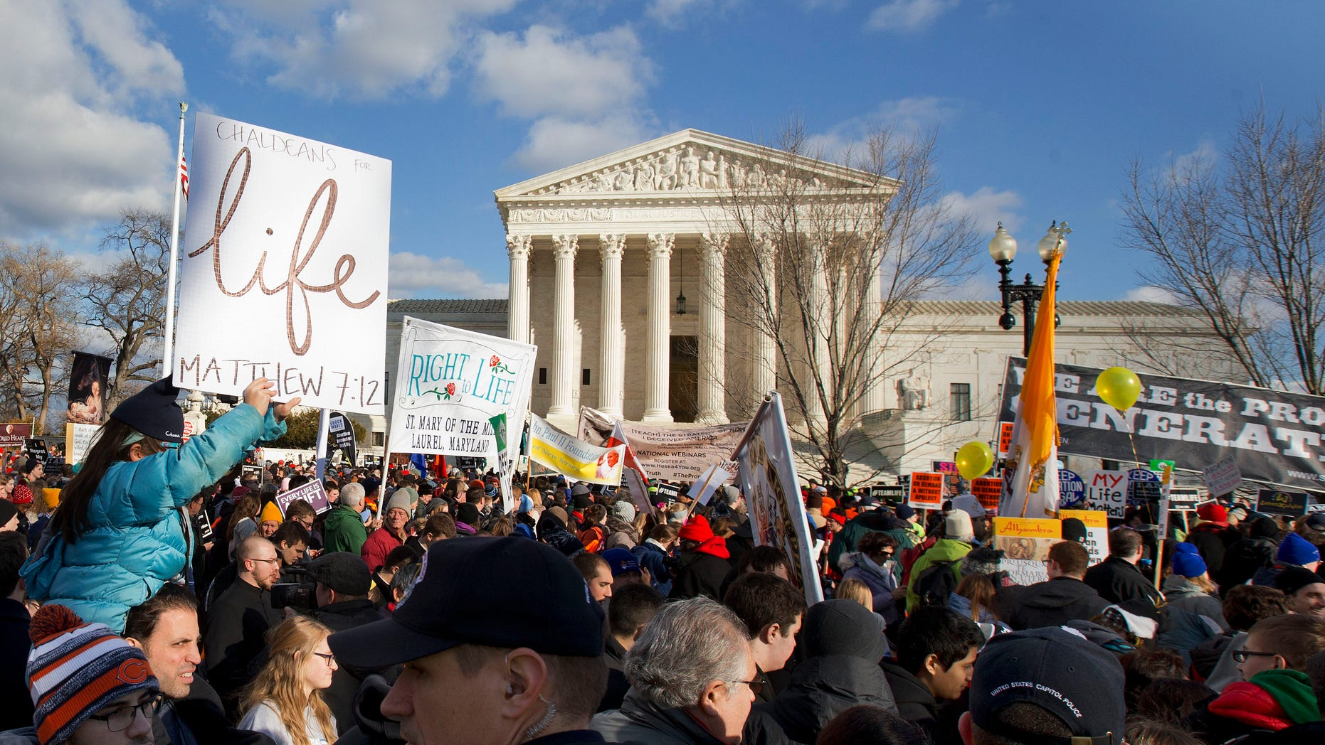 FILE -- Jan. 22, 2015: Anti-abortion demonstrators march past the Supreme Court in Washington, during the annual March for Life.
