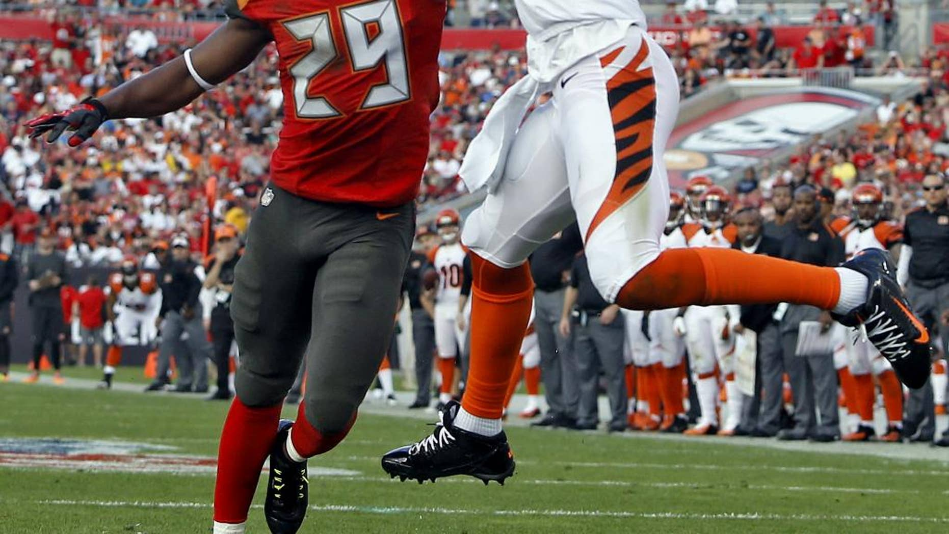 Cincinnati Bengals wide receiver A.J. Green (18) pulls in a 13-yard touchdown reception in front of Tampa Bay Buccaneers cornerback Leonard Johnson (29) during the third quarter of an NFL football game Sunday, Nov. 30, 2014, in Tampa, Fla. (AP Photo/Brian Blanco)
