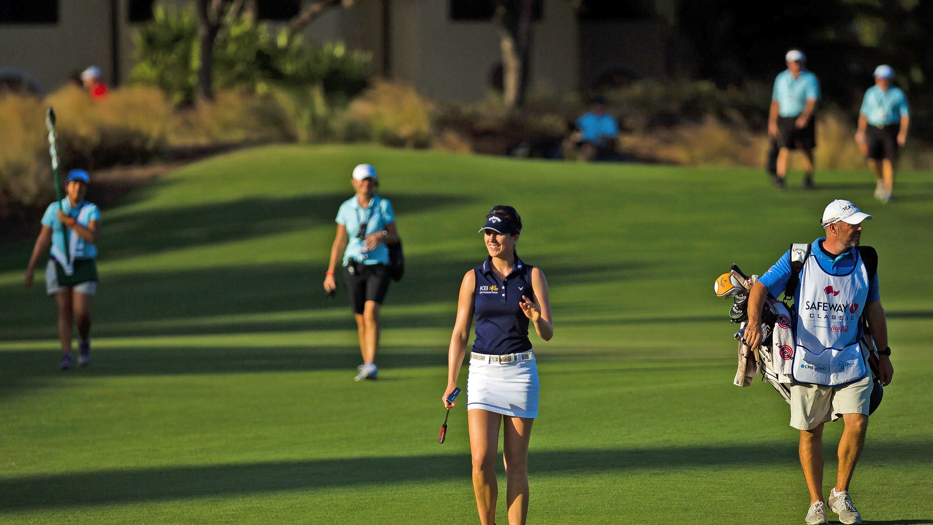 Sandra Gal waves to the crowd as she approaches the 18th green while playing in the second round of the LPGA Titleholders at the Tiburon Golf Club on Friday, Nov. 22, 2013, in Naples, Fla. Gal built a three-shot lead in the second round of the tournament.  (AP Photo/Naples Daily News, David Albers) FORT MYERS OUT