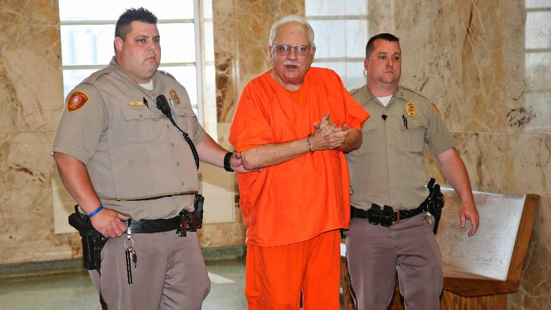 Robert Bates, a former Oklahoma volunteer sheriff's deputy who said he mistook his handgun for his stun gun when he fatally shot an unarmed suspect last year, is escorted to the courtroom for his sentencing at the courthouse in Tulsa, Okla., Tuesday, May 31, 2016. Bates was convicted of second-degree manslaughter. (AP Photo/Sue Ogrocki)