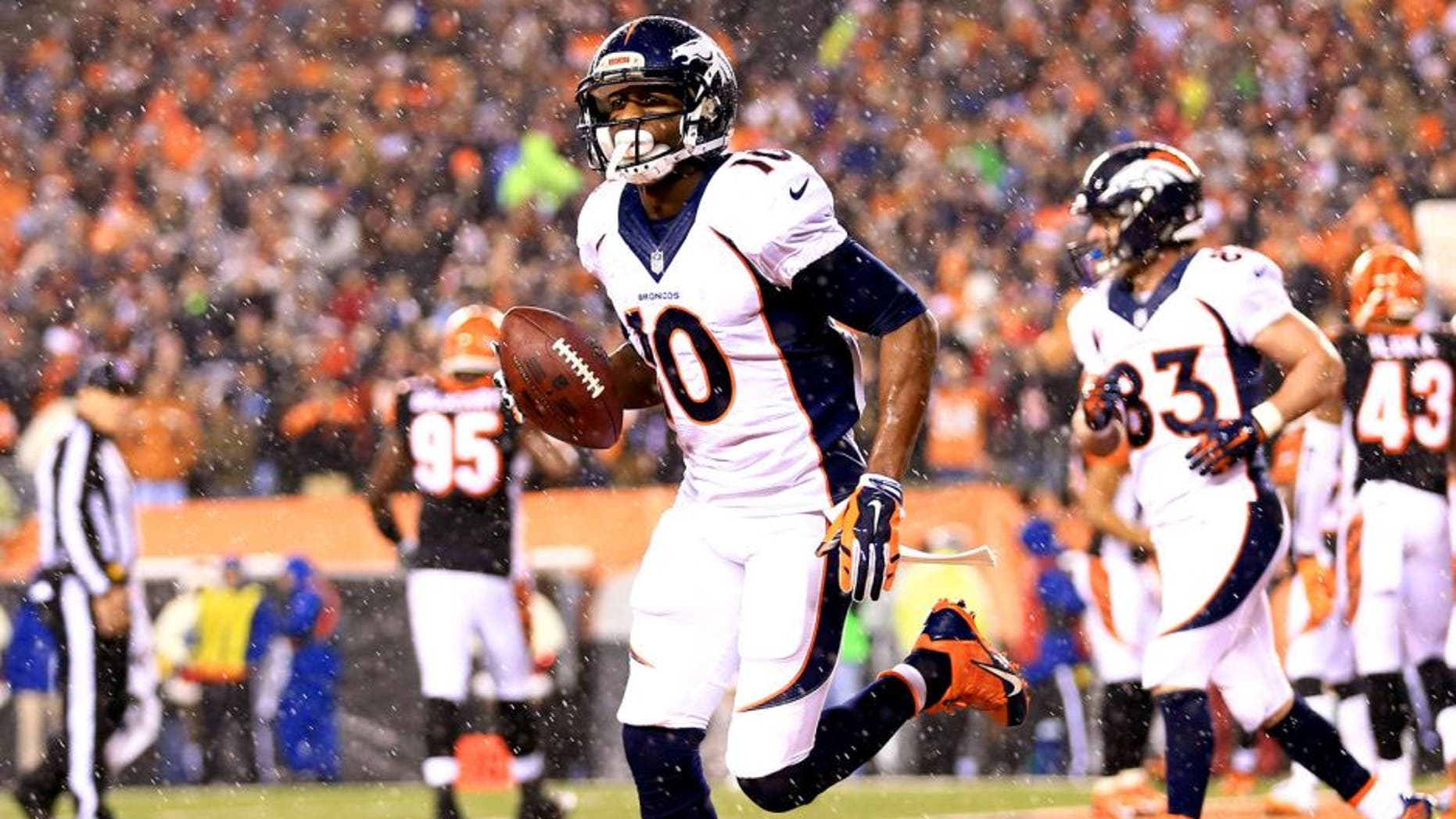 Dec 22, 2014; Cincinnati, OH, USA; Denver Broncos wide receiver Emmanuel Sanders (10) celebrates after catching a pass for a touchdown during the third quarter against the Cincinnati Bengals at Paul Brown Stadium. Mandatory Credit: Andrew Weber-USA TODAY Sports