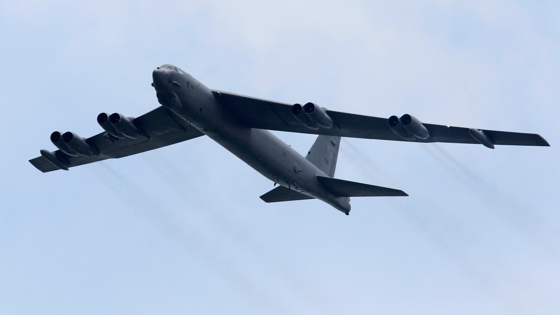 File photo - A Boeing B-52 Stratofortress strategic bomber from the United States Air Force (USAF) Andersen Air Force Base in Guam performs a fly-past during an aerial display at the Singapore Airshow in Singapore February 14, 2012. (REUTERS/Tim Chong)