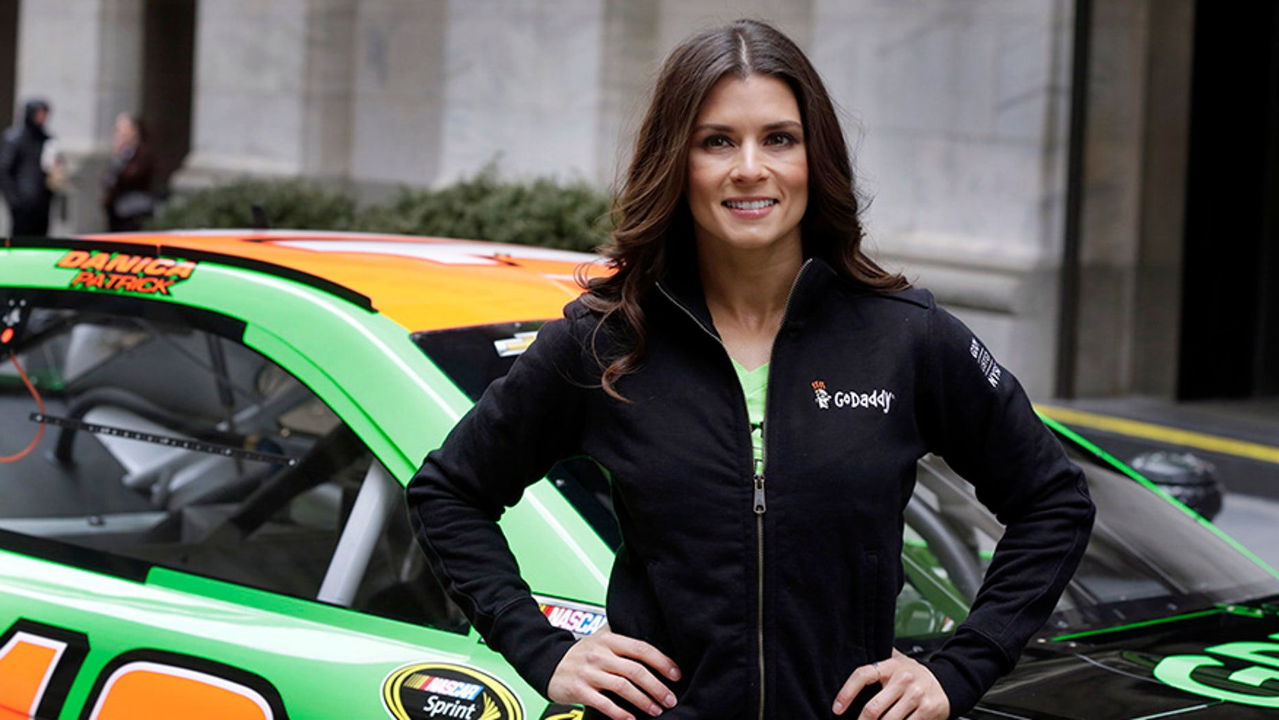 Danica Patrick stands in front of the New York Stock Exchange ahead of GoDaddy's 2015 IPO.