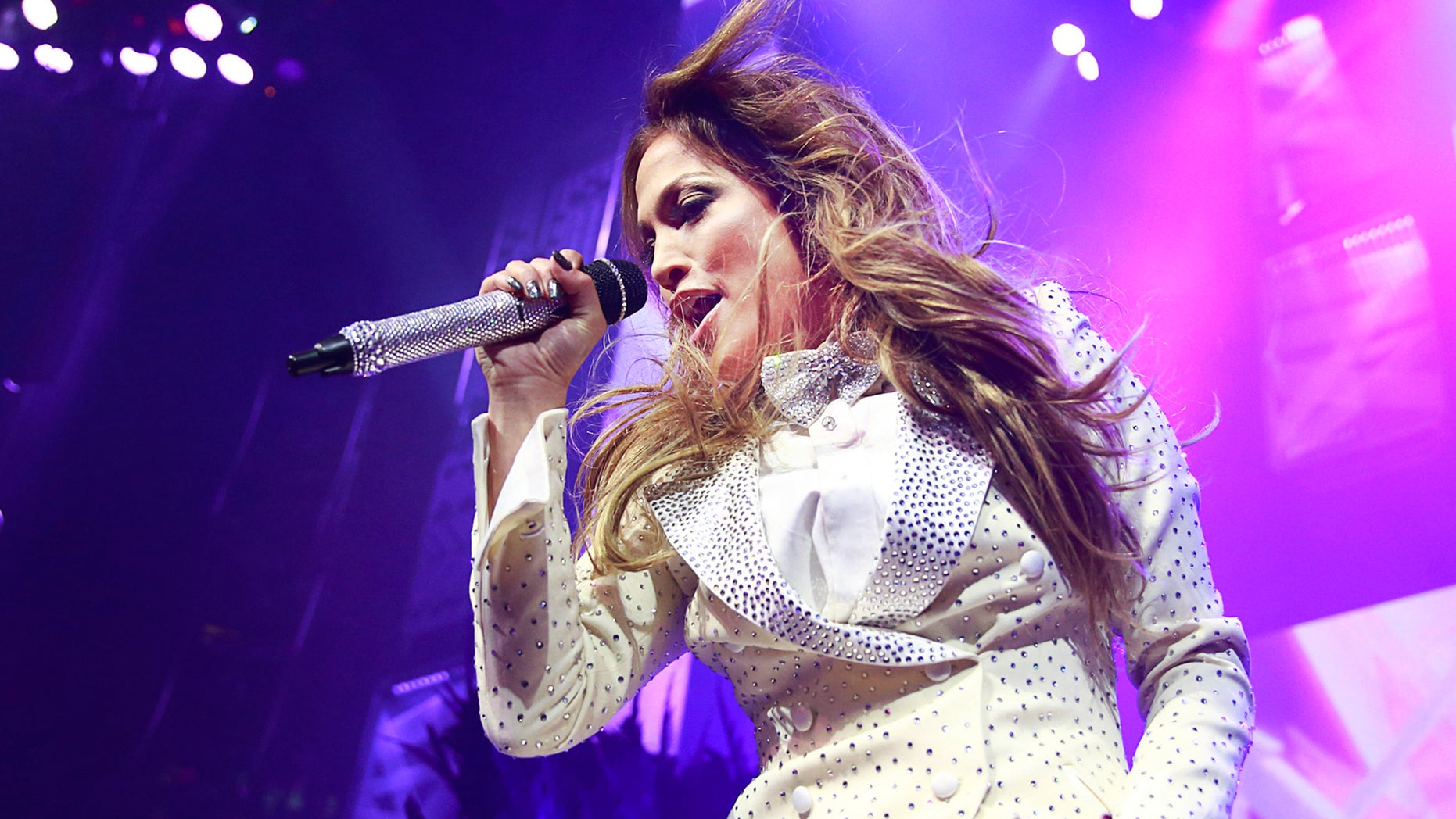 VANCOUVER, BC - OCTOBER 22:  Multi-platinum, award-winning performer and actress, Jennifer Lopez, makes a surprise appearance at We Day at Rogers Arena on Wednesday October 22, 2014 in Vancouver, British Columbia, Canada. She performed a medley of her greatest hits in front of a live audience of 20,000 students. (Photo by Jeff Vinnick/Getty Images for Free The Children)