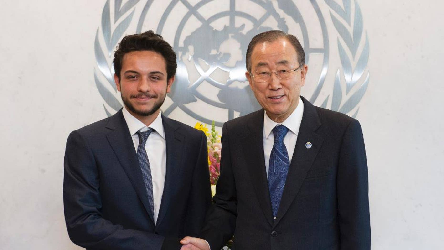 In this photo provided by the United Nations, Crown Prince Al Hussein Bin Abdullah II, Hashemite Kingdom of Jordan, left, shakes hands with United Nations Secretary General Ban Ki-moon at United Nations headquarters, Thursday, April 23, 2015. On Thursday, Jordan's 20-year-old crown prince became the youngest person ever to chair a meeting of the U.N. Security Council. (Mark Garten/The United Nations via AP)
