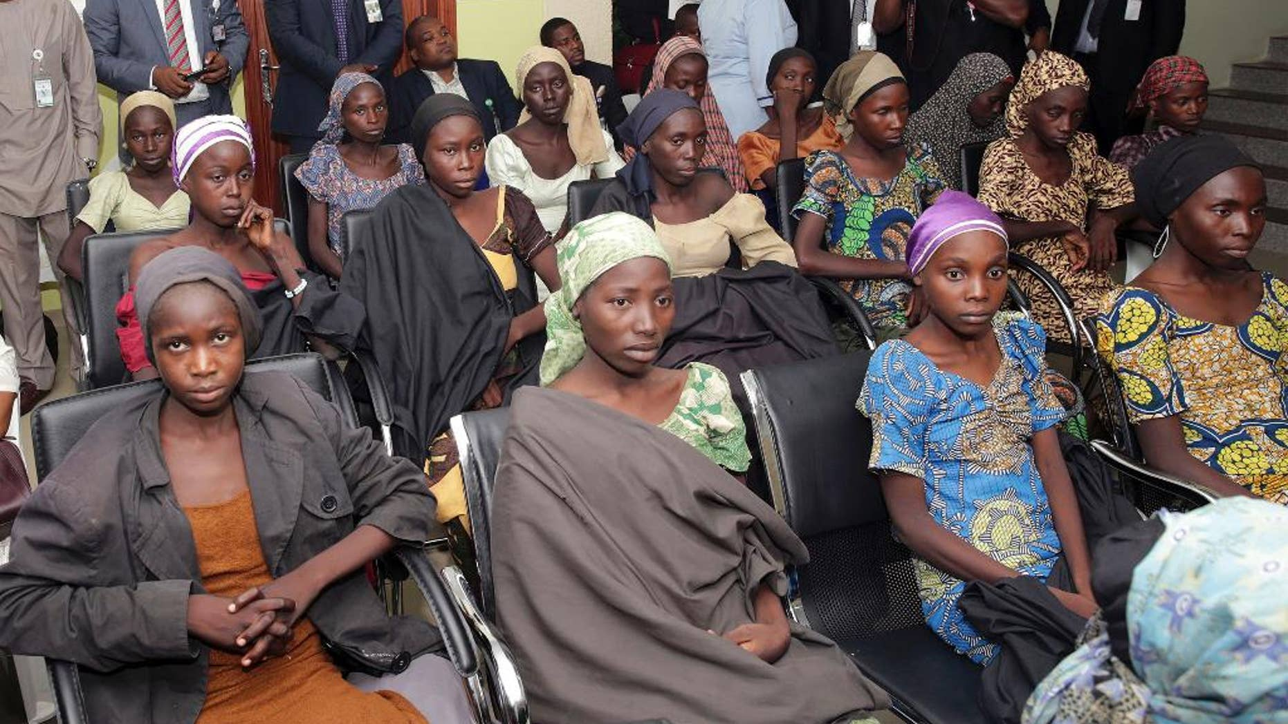 FILE - In this Thursday, Oct. 13, 2016 file photo released by the Nigeria State House, Chibok schoolgirls recently freed from Islamic extremist captivity are seen during a meeting with Nigeria's Vice President Yemi Osinbajo in Abuja, Nigeria. Large numbers of Chibok schoolgirls seized three years ago by Boko Haram have been freed in exchange for detained suspects with the extremist group, Nigeria's government announced early Sunday, May 7, 2017 in the largest release negotiated yet in the battle to save nearly 300 girls whose mass abduction exposed the mounting threat posed by the Islamic State-linked fighters. After the initial release of 21 Chibok girls in October, the government denied making an exchange or paying ransom. (Sunday Aghaeze/Nigeria State House via AP, File)