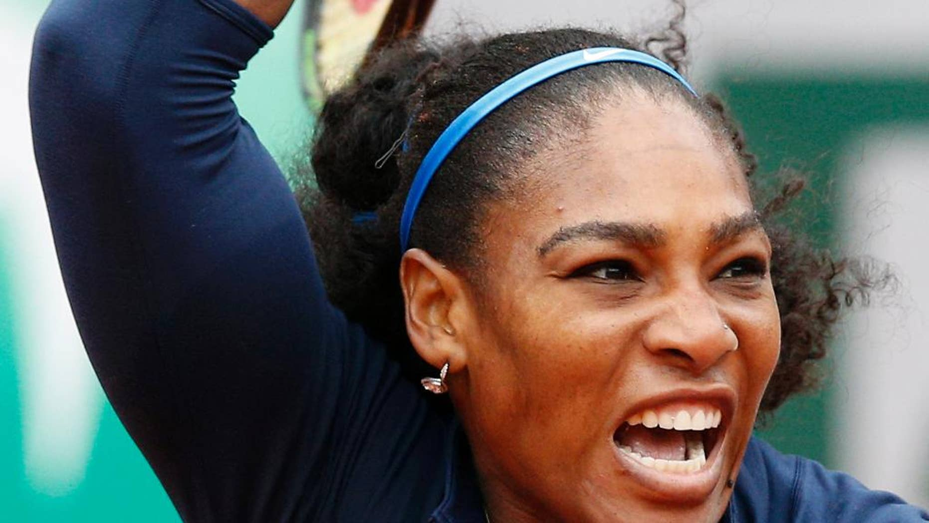 Serena Williams of the U.S. returns the ball to Ukraine's Elina Svitolina  during their fourth round match of the French Open tennis tournament at the Roland Garros stadium, Wednesday, June 1, 2016 in Paris.  (AP Photo/Christophe Ena)