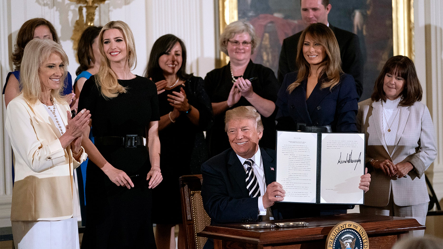 First Lady Melania Trump and senior adviser Ivanka Trump sported dark, belted dresses to a May 9 engagement.