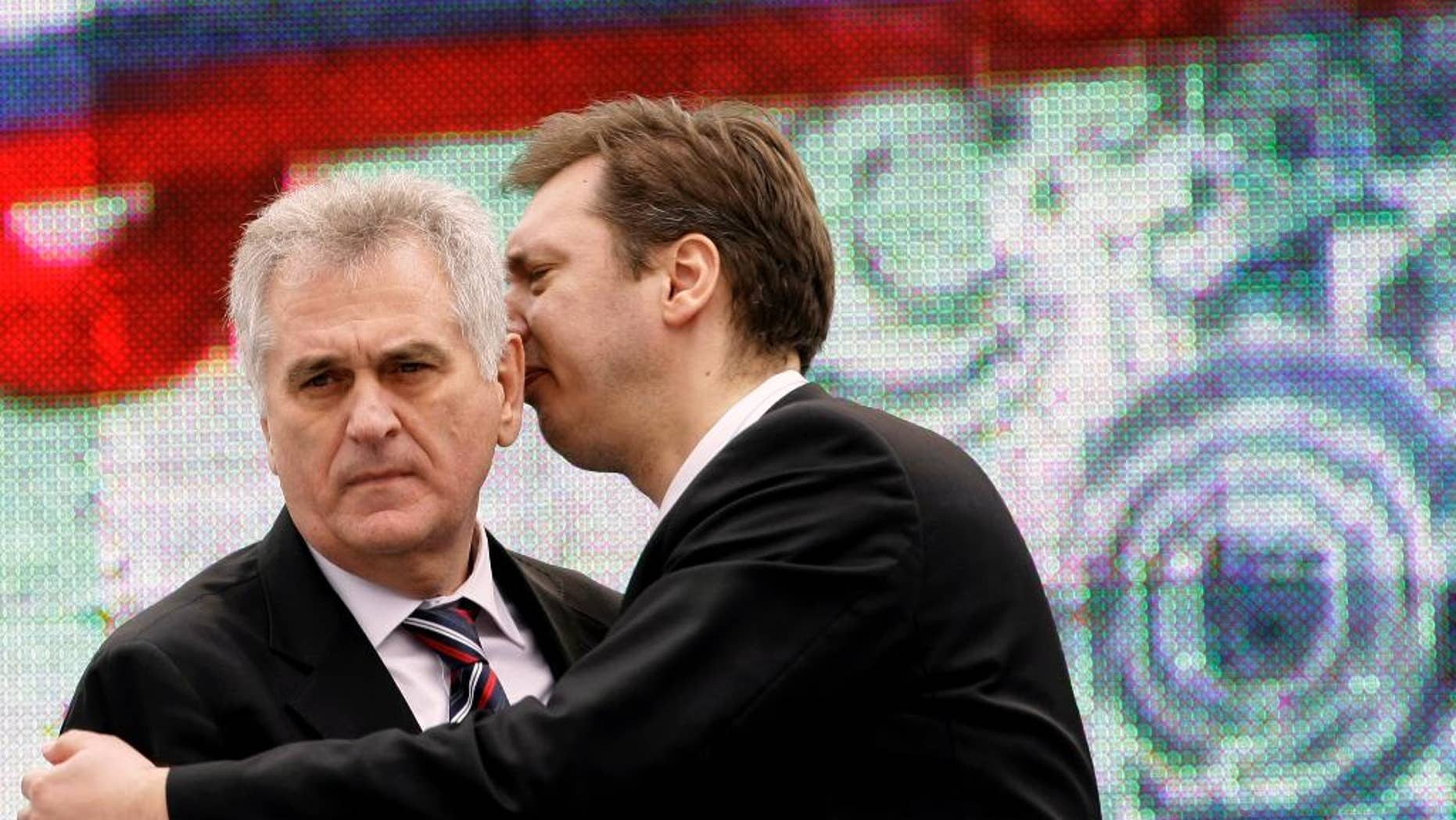 In this April 16, 2011 photo, Serbian Prime Minister Aleksandar Vucic, right, speaks with Serbian President Tomislav Nikolic during a protest rally in Belgrade, Serbia. Nikolic has lashed out against the outgoing U.S. administration expressing hope President-elect Donald Trump will be more favourable toward Serbia and its Russia-backed claim over Kosovo. (AP Photo/Darko Vojinovic)