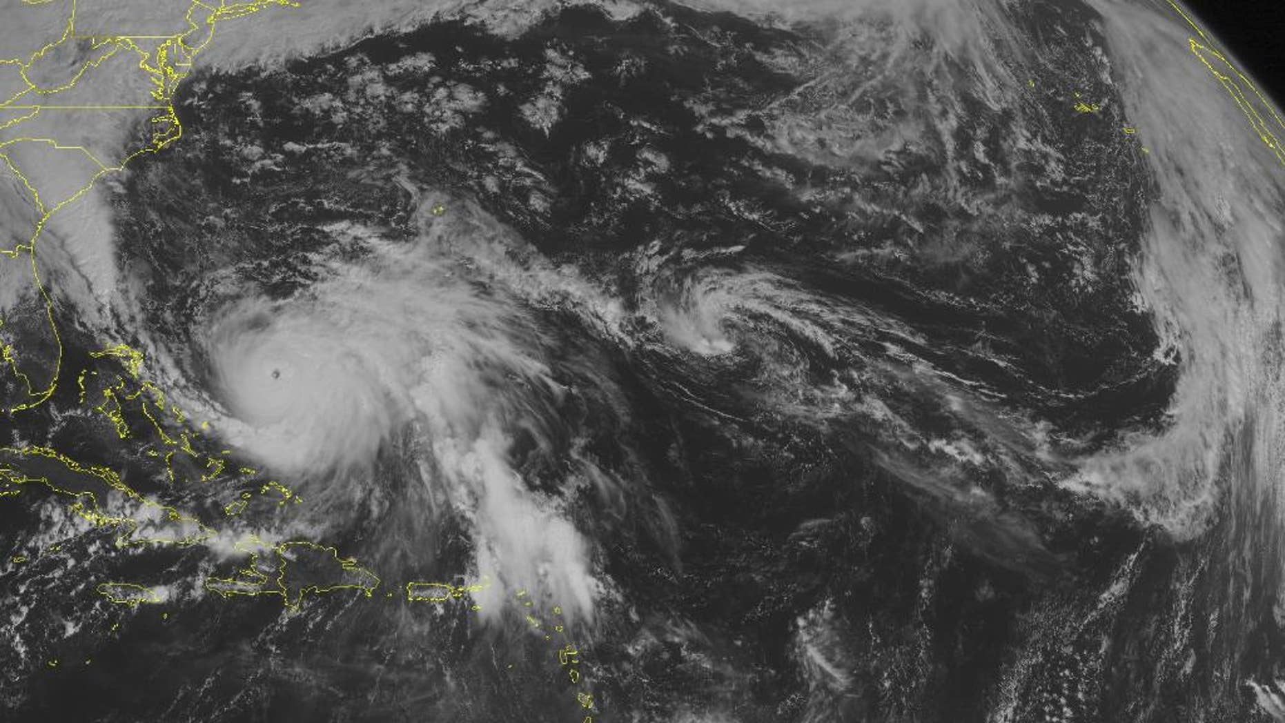 This NOAA satellite image taken Saturday, Oct. 3, 2015 at 09:45 AM EDT shows major hurricane Joaquin, located east of the Bahamas and moving towards the northeast with maximum sustained winds of 155 miles per hour. Clouds with rain and thunderstorms are affecting Cuba and Haiti, Puerto Rico, and the northern Virgin Islands. (Weather Underground via AP)