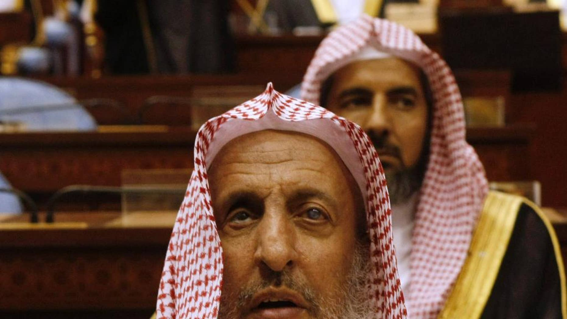 "FILE - In this Tuesday, March 24, 2009 file photo, Sheikh Abdul Aziz al-Sheikh, the Saudi grand mufti listens to a speech of King Abdullah of Saudi Arabia at the Consultative Council in Riyadh, Saudi Arabia. Saudi Arabia's top cleric has said that Iranians are ""not Muslims,"" adding fuel to a spat between the two regional powers a day after Iran's supreme leader accused the kingdom of mistreating pilgrims injured during last year's Hajj stampede. (AP Photo/Hassan Ammar, File)"