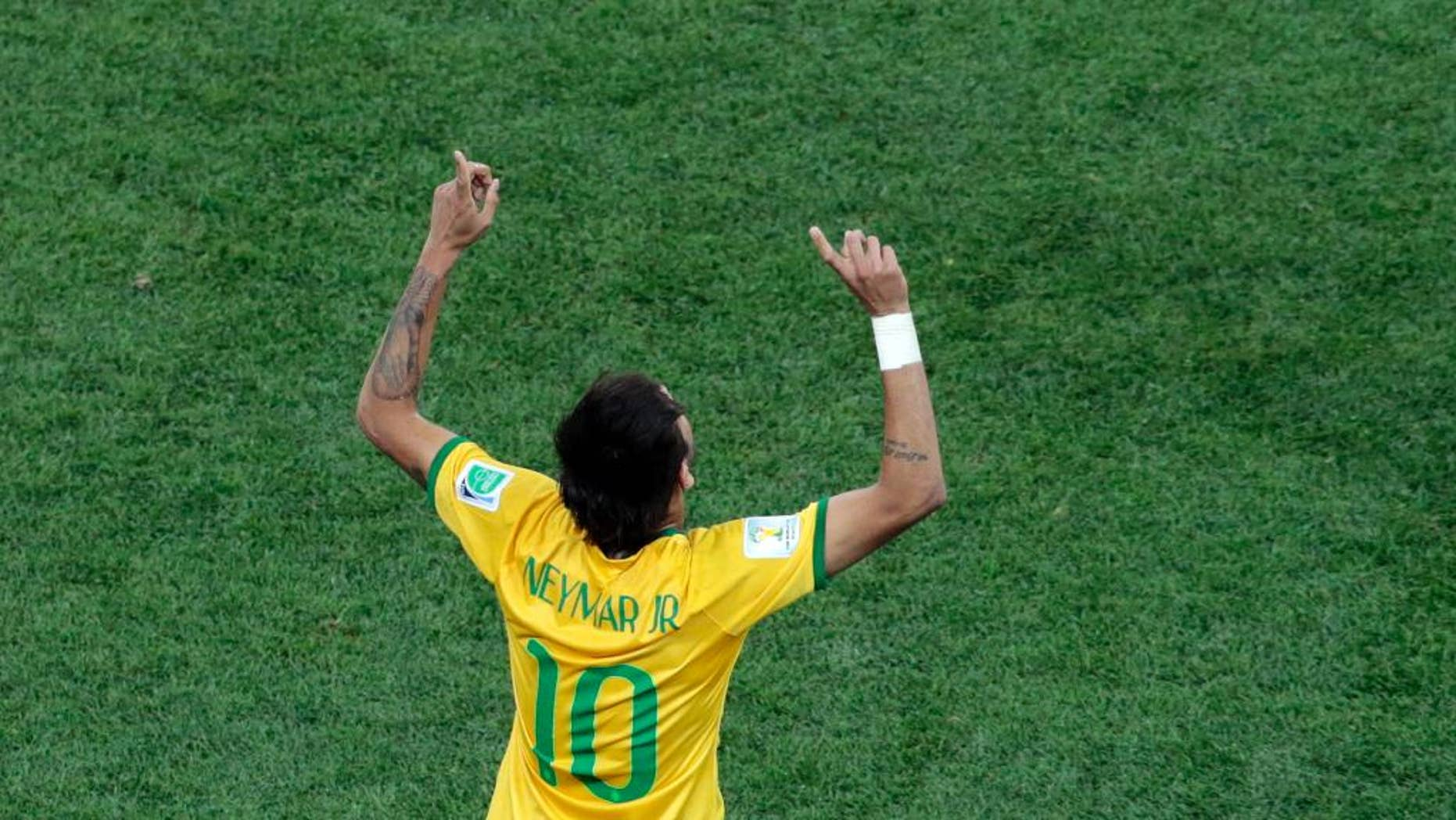 Brazil's Neymar celebrates scoring his side's first goal during the group A World Cup soccer match between Brazil and Croatia, the opening game of the tournament, in the Itaquerao Stadium in Sao Paulo, Brazil, Thursday, June 12, 2014.  (AP Photo/Shuji Kajiyama)