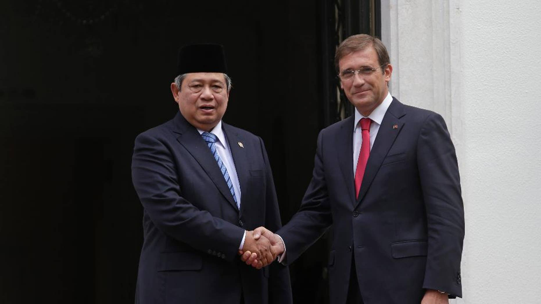 Indonesia's President Susilo Bambang Yudhoyono, left, shakes hands for the media with the Portuguese Prime Minister Pedro Passos Coelho before their meeting at the Sao Bento palace, the premier's official resident, in Lisbon, Friday, Sept. 19, 2014. The one day state visit of Yudhoyono was the first that an Indonesian President paid to Portugal since 1960. Bilateral relations between the two countries were severed during years after Indonesia annexed in 1975 East Timor, a former Portuguese colony. (AP Photo/Francisco Seco)