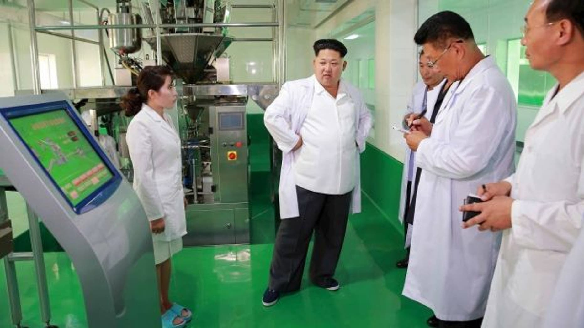 North Korean leader Kim Jong Un provides field guidance to the newly built Pyongyang Corn Processing Factory