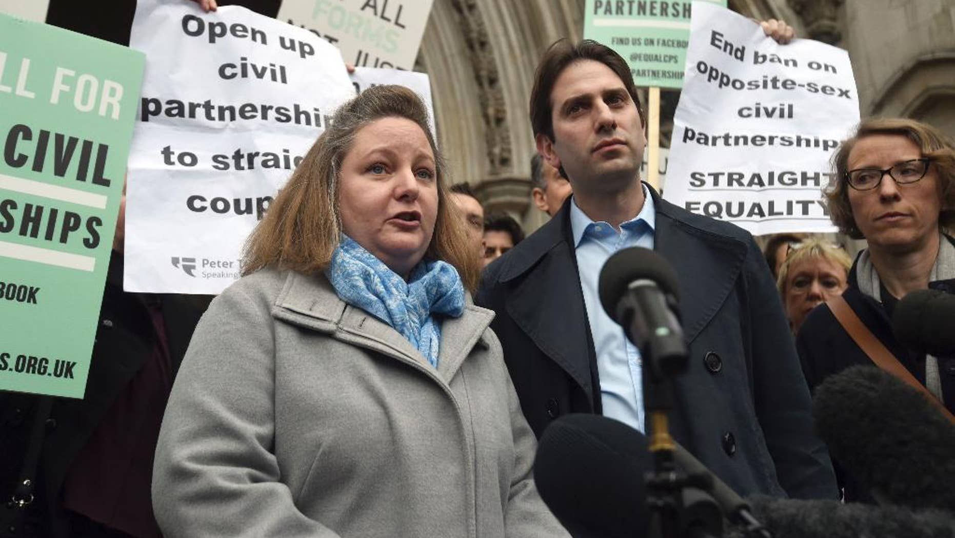 "Rebecca Steinfeld, left, and Charles Keidan speak to the media outside the Royal Courts of Justice in London, Tuesday, Feb. 21, 2017. A British couple who want their relationship recognized in law without the ""patriarchal baggage"" of marriage have lost a bid to be allowed a civil partnership. Rebecca Steinfeld and Charles Keidan say they face discrimination because only same-sex couples are eligible for civil partnerships. The High Court ruled against them last year, and on Tuesday the Court of Appeal upheld the ruling by a 2-1 margin. (Charlotte Ball/PA via AP)"